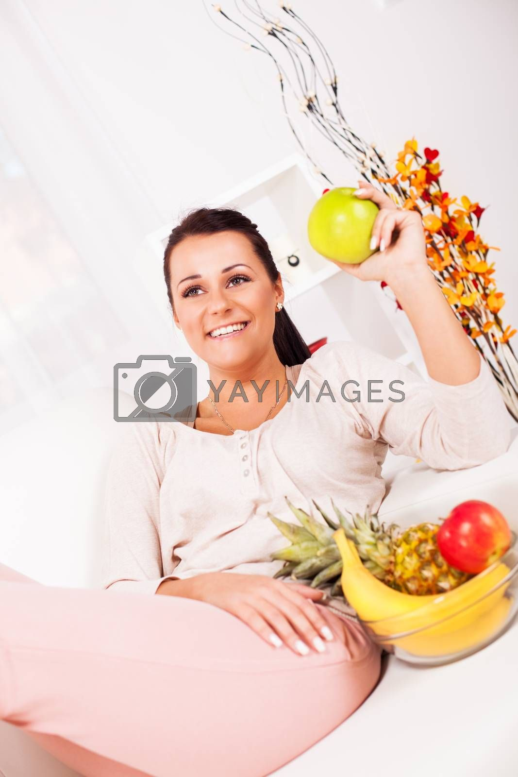 Beautiful young woman with fruits.