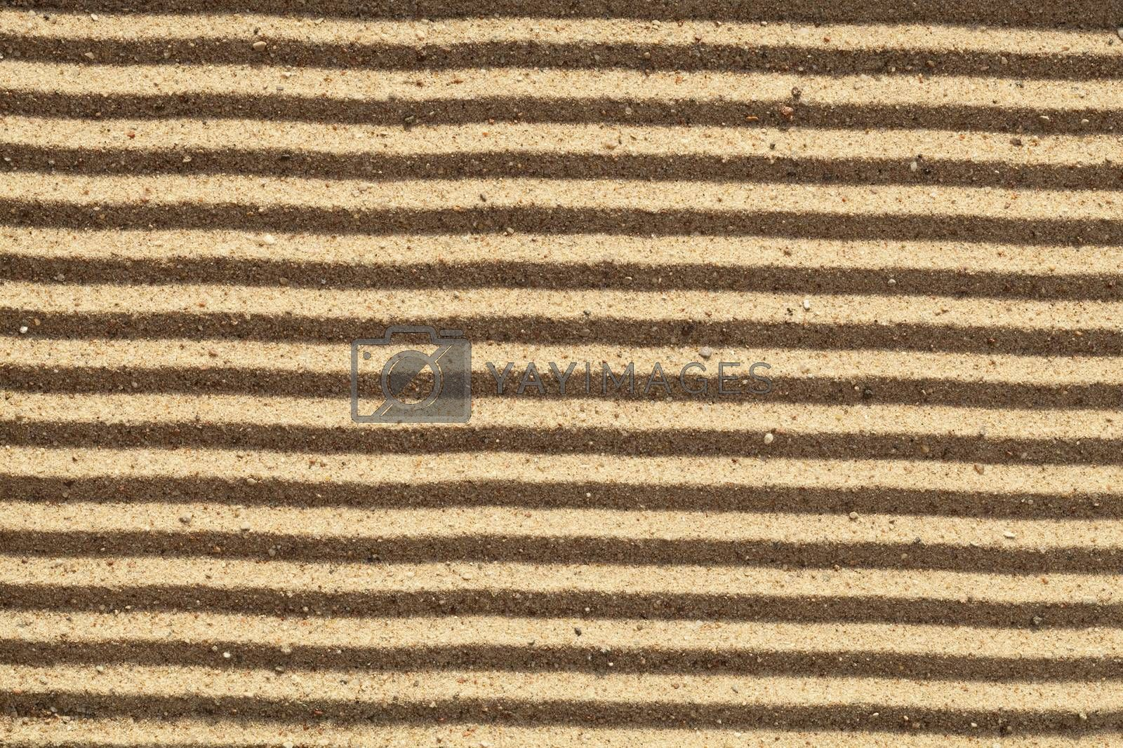 yellow dry sand in stripes as background