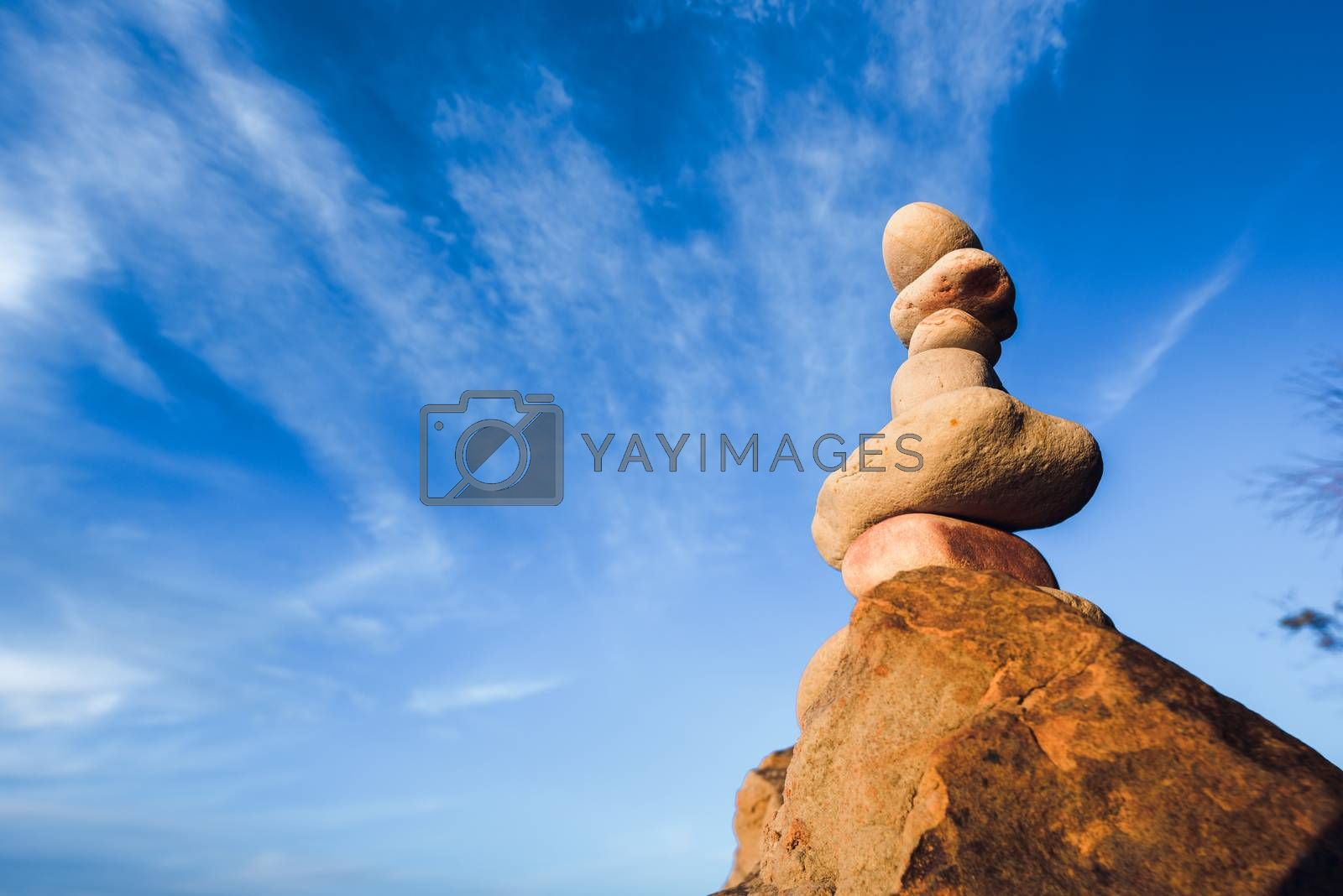 Balancing of stones each other on sky background