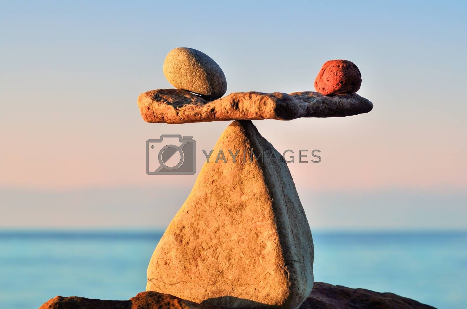 Well-balanced stack of pebbles on the shore