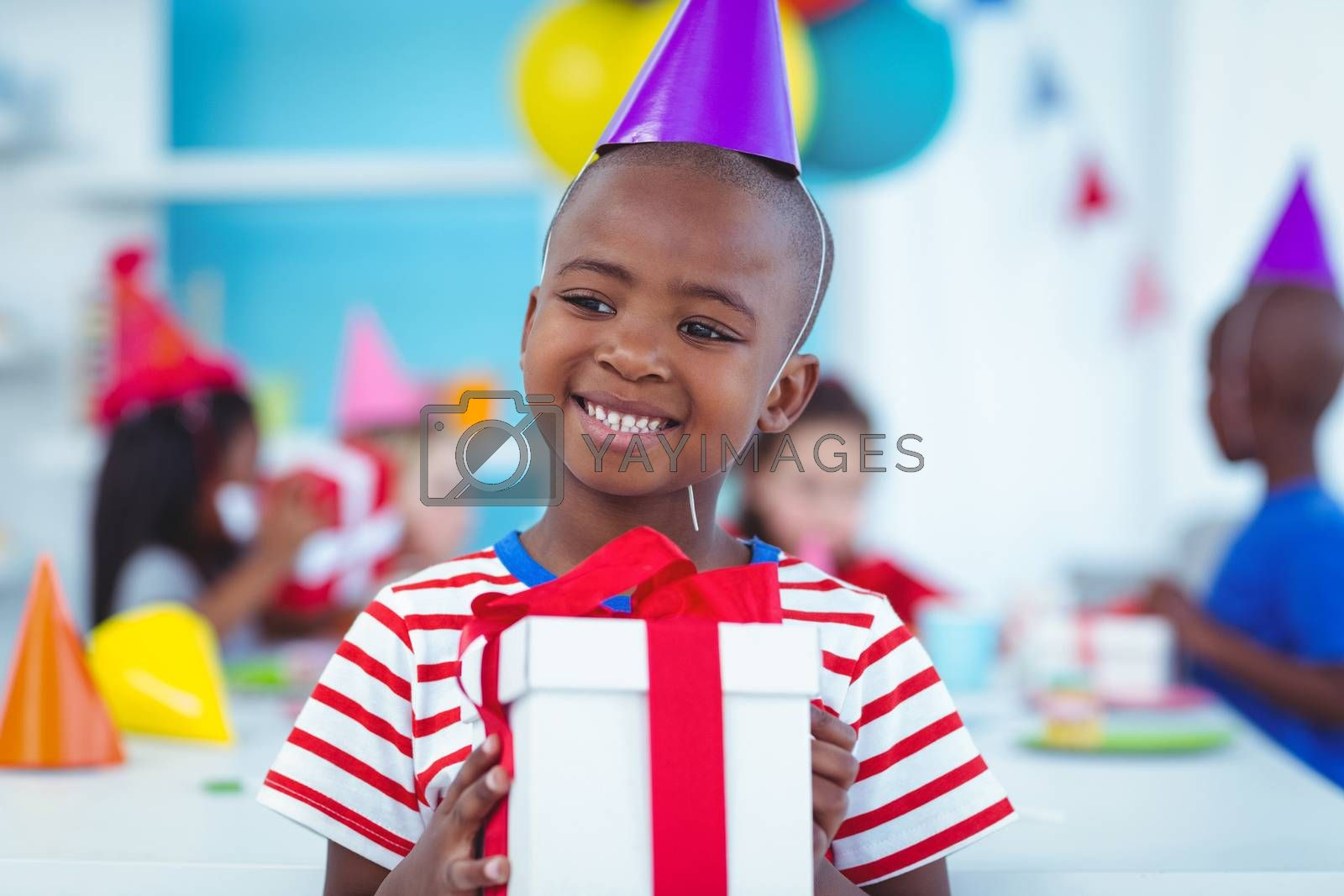 Happy kids at a birthday party about to open presents
