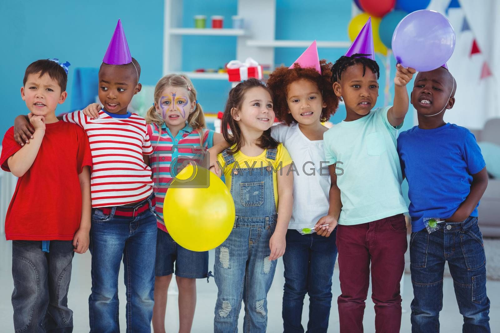 Happy kids enjoying a birthday party standing together
