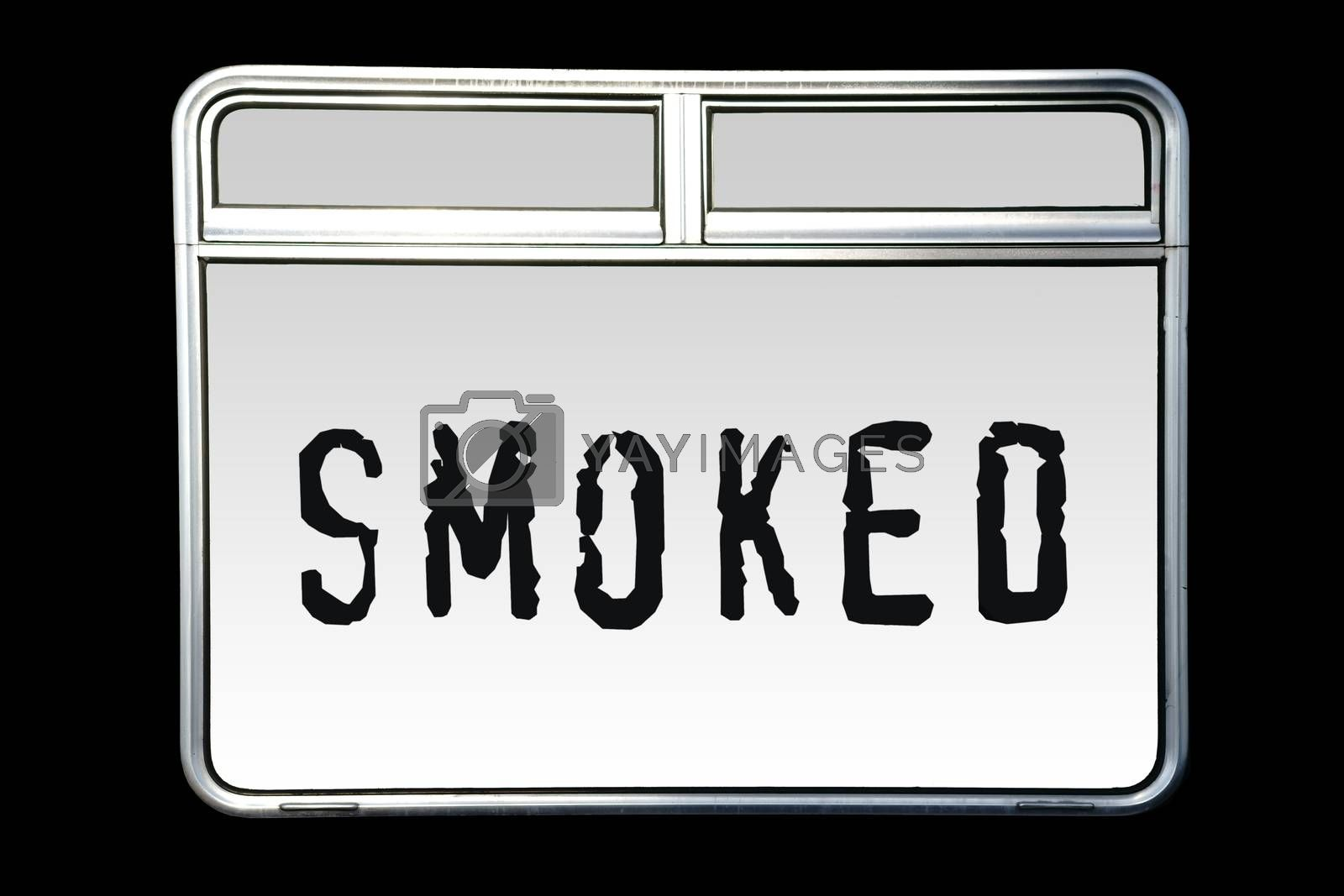 An abstract shiny metallic train window with the word Smoked.