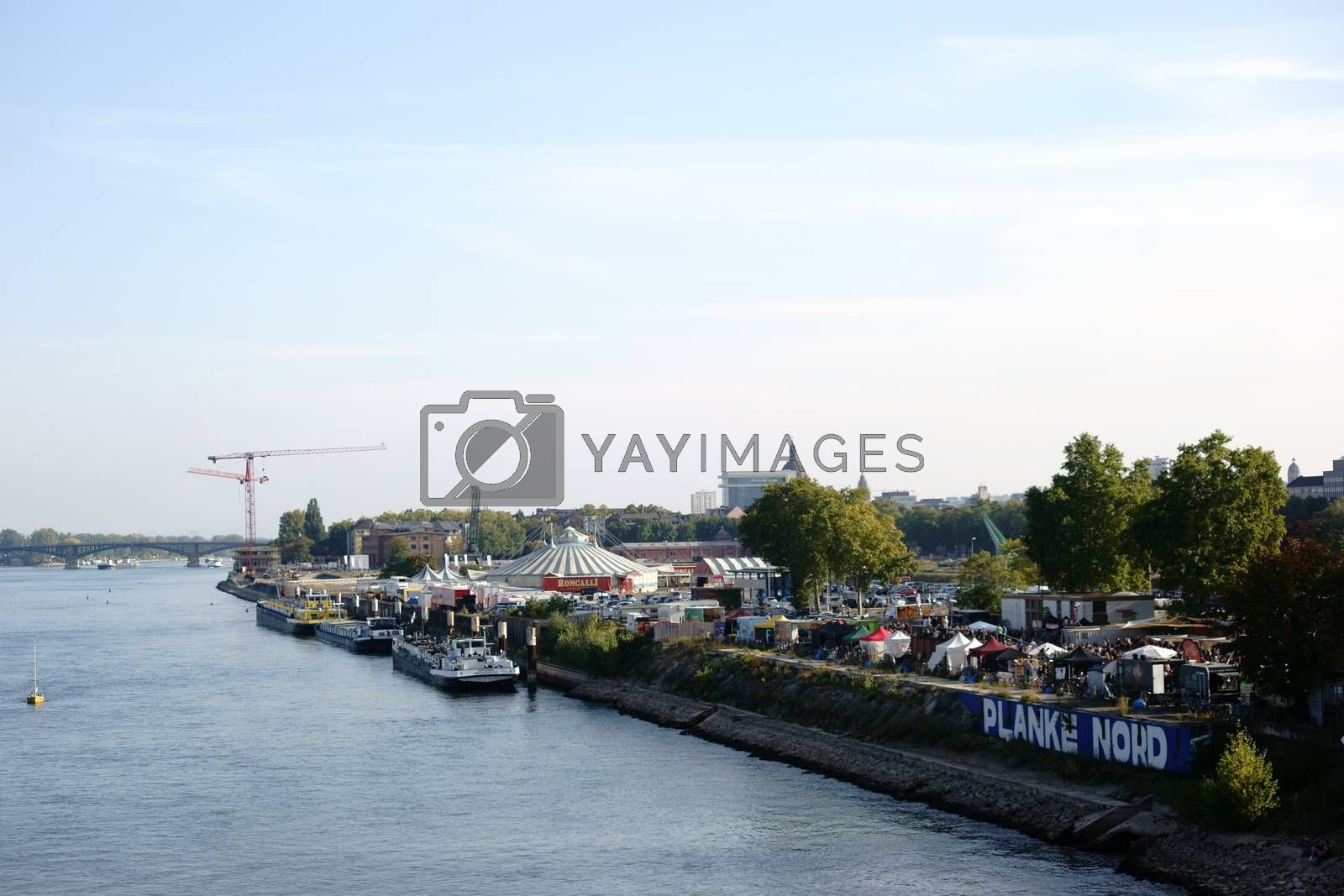 Mainz, Germany - October 02, 2015: The view over the river Rhine and the city of Mainz with a street food festival at the plank North on October 02, 2015 in Mainz.
