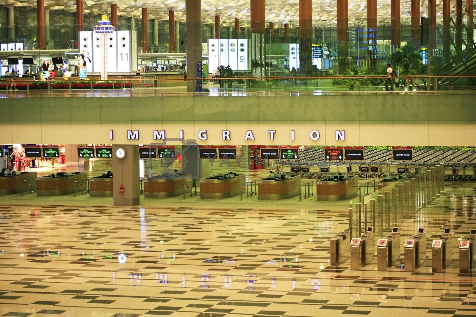 Singapore, Singapore - November 12, 2008: Inside view of Changi International Airport. Hall of immigration. Changi is a major aviation hub in Asia, serves more than 100 airlines operating 6,100 weekly flights connecting Singapore to over 220 cities.