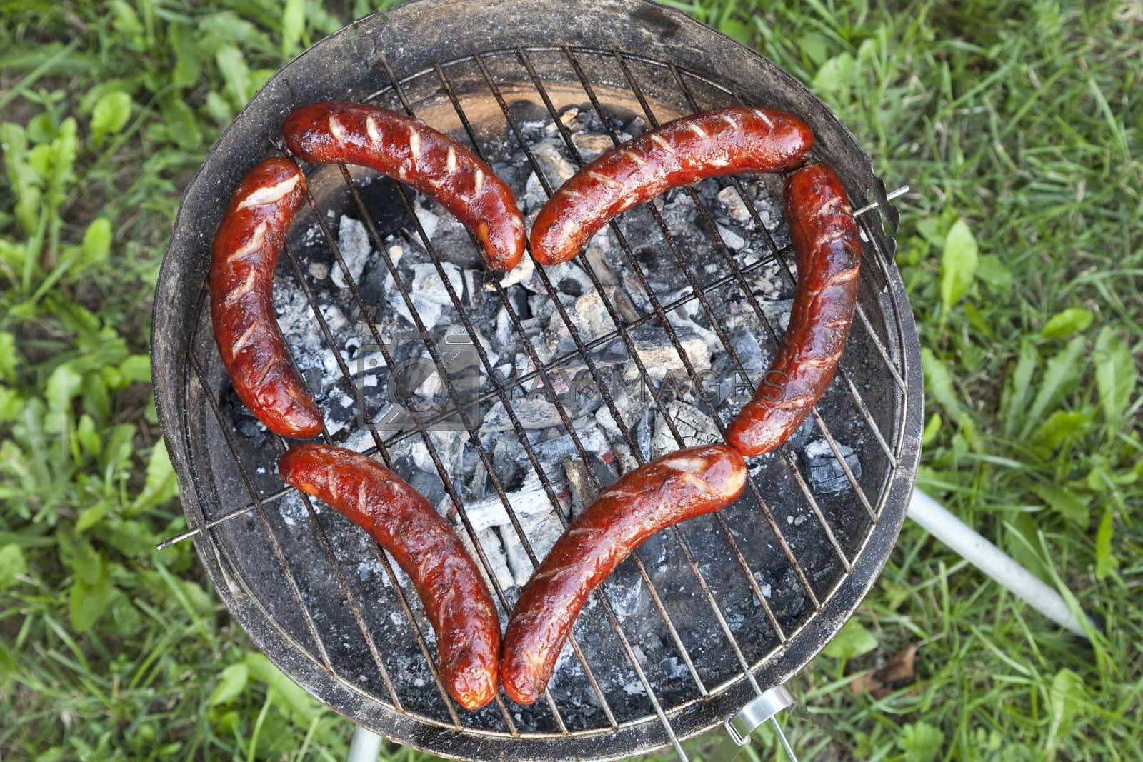 sausage on grill arranged in shape of heart
