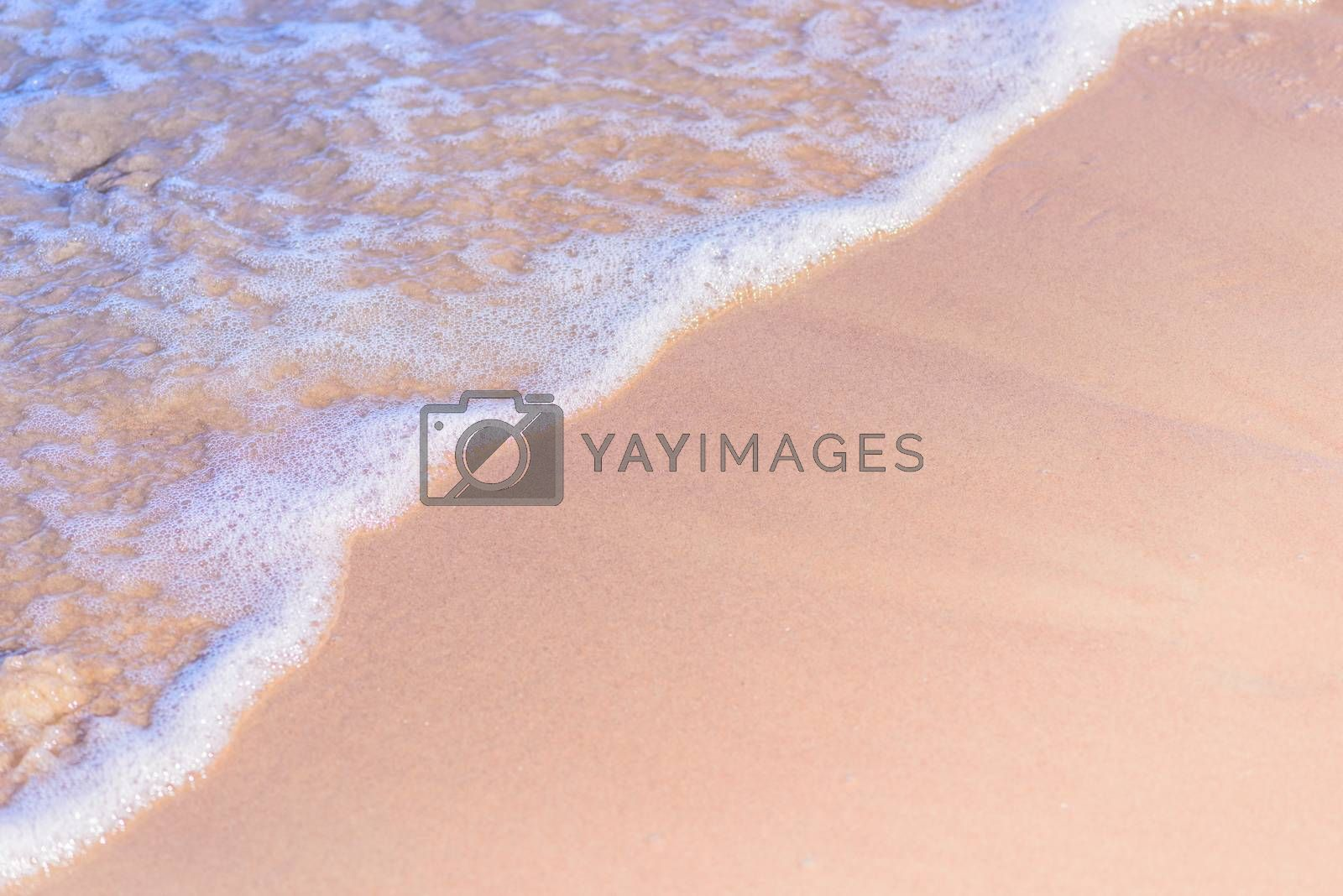 Transparent soft waves on the sandy beach