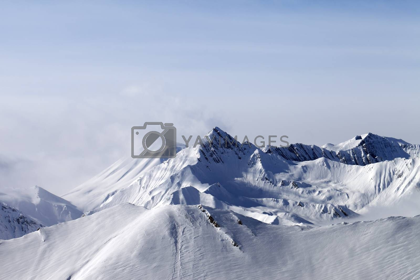 Mountain covered in white snow.