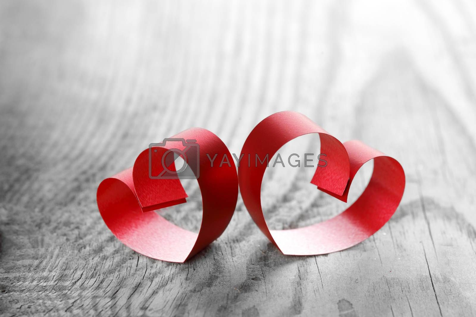 Red ribbon hearts on wooden background, Valentines day concept