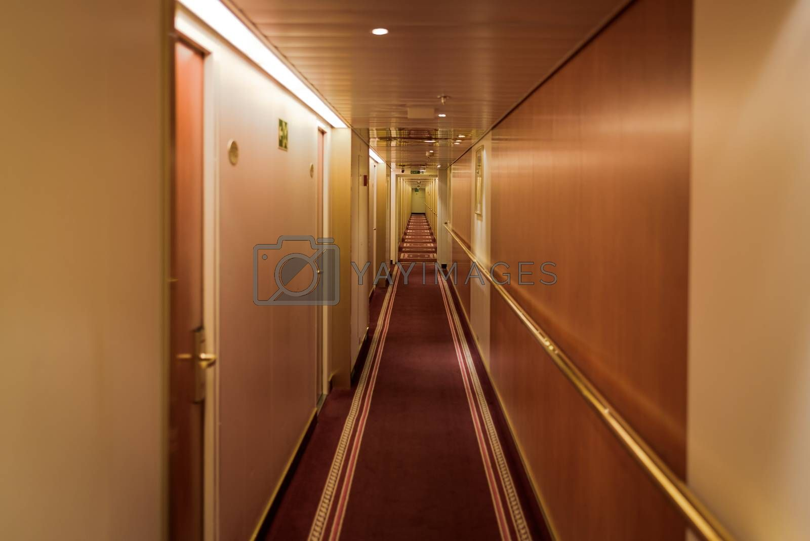 Narrow corridor with cabins at cruise ferry