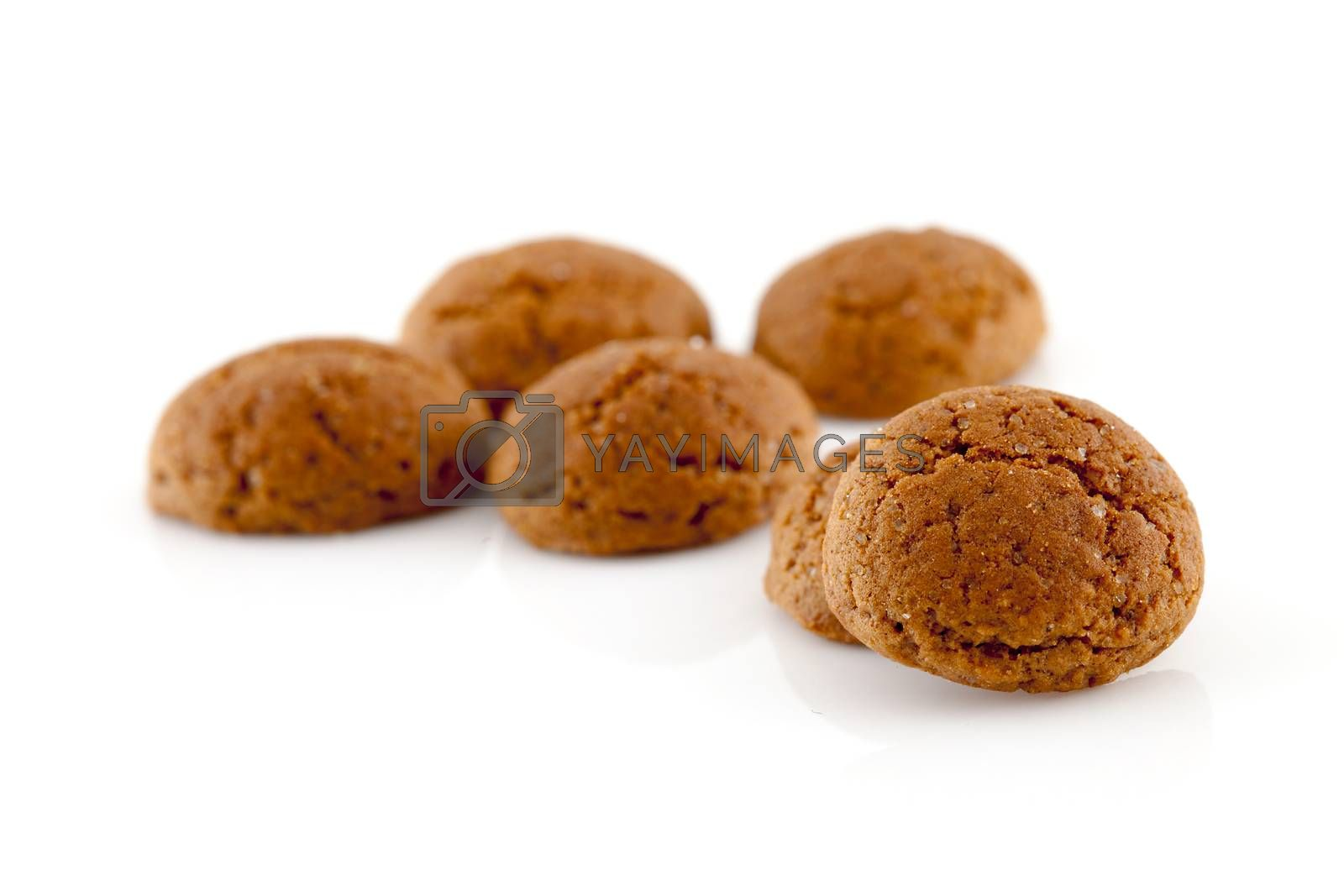 Typical dutch sweets: pepernoten (ginger nuts) for a celebration at 5 december in the Netherlands over white background
