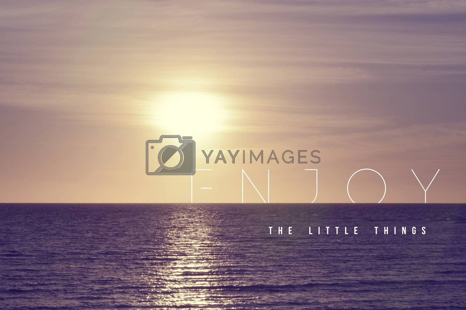 Enjoy the little things motivational inspiring quote concept with soft light summer sunset landscape background ideal for print card and poster design.