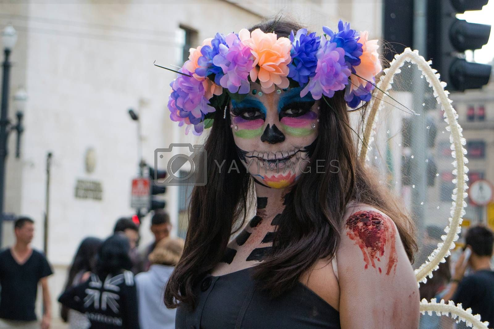 Sao Paulo, Brazil November 11 2015: An unidentified girl in traditional skull costumes in the annual event Zombie Walk in Sao Paulo Brazil.