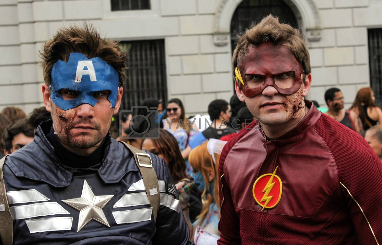 Sao Paulo, Brazil November 11 2015: Two unidentified men in super heroes costumes in the annual event Zombie Walk in Sao Paulo Brazil.