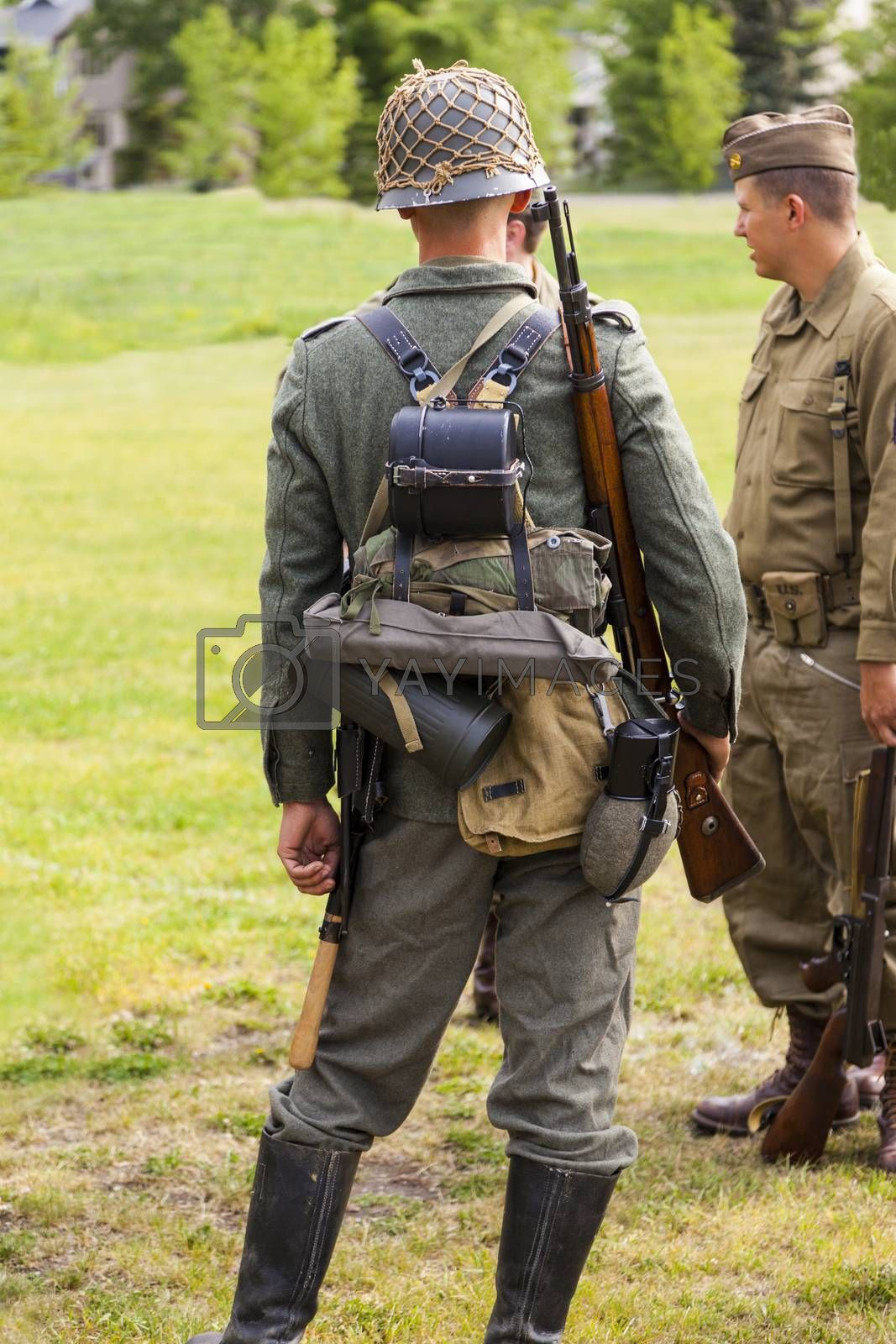 "CALGARY CANADA JUN 13 2015: The Military Museum organized ""Summer Skirmish"" event where an unidentified soldier is seen in a historical Reenactment Battle. German and US soldiers in uniform."