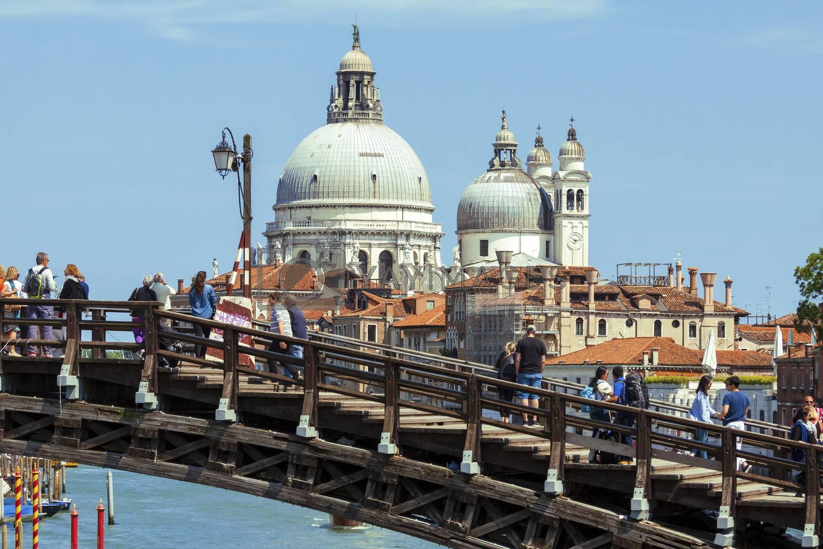 VENICE, ITALY - MAY 28, 2015: Accademia bridge with Basilica di Santa Maria della Salute in Venice, Italy