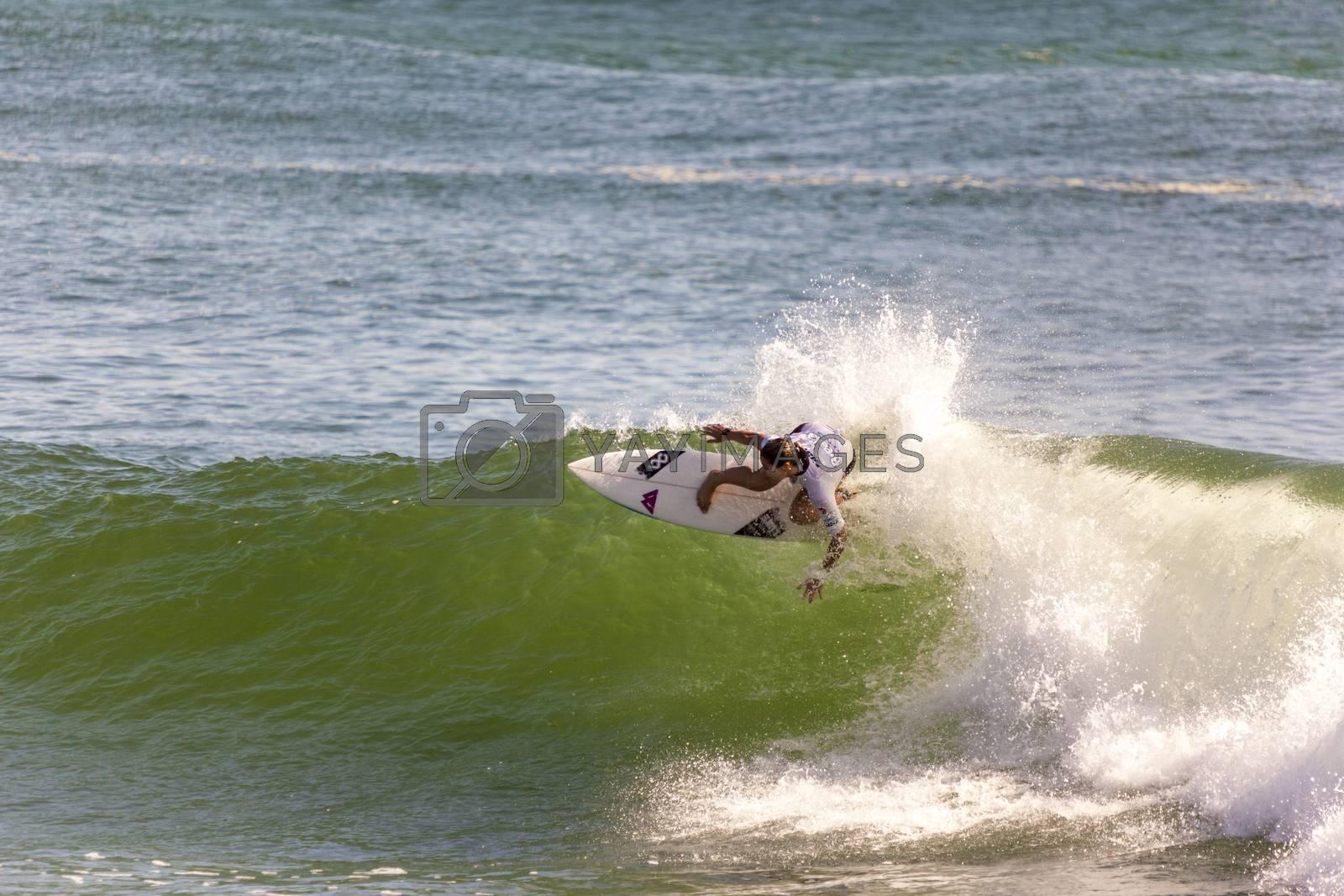 BREAKA BURLEIGH PRO 2013 , GOLD COAST, AUSTRALIA - FEB 3: Unidentified professional female surfer compete on the Burleigh Pro 2013 event, February 3, 2013, Burleigh , Gold Coast, Australia