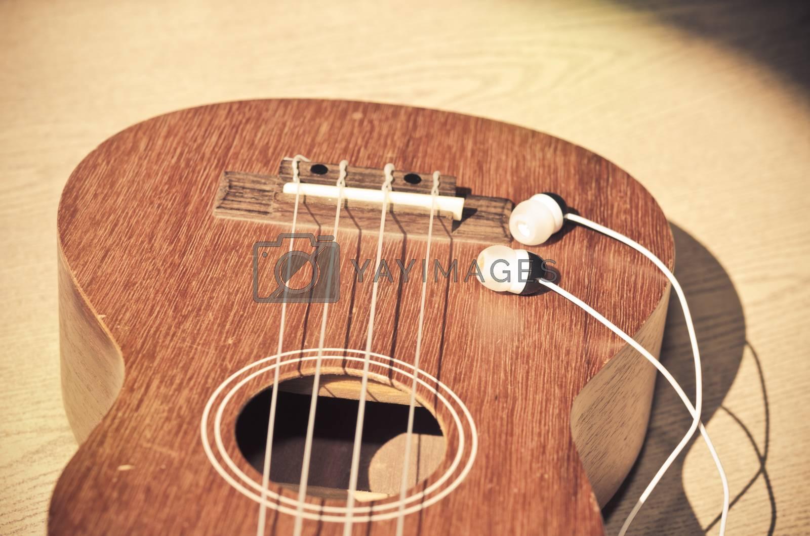 The Ukulele and headphones. Vintage photo retouching