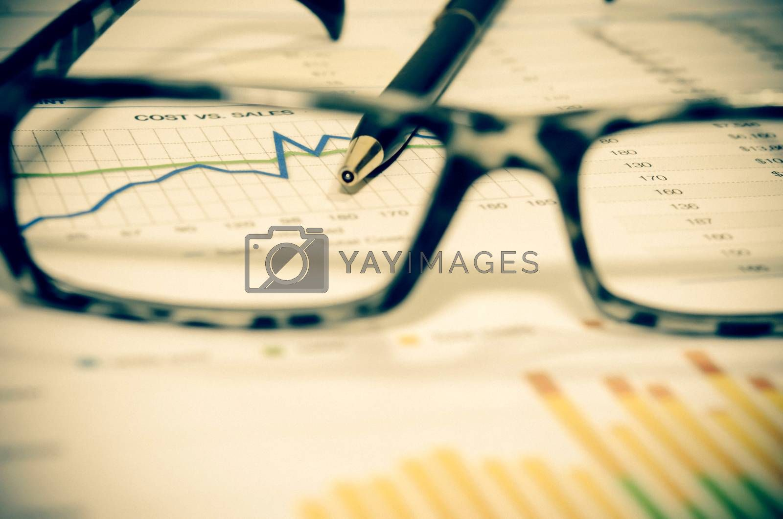 Glasses and business documents.vintage style color effect