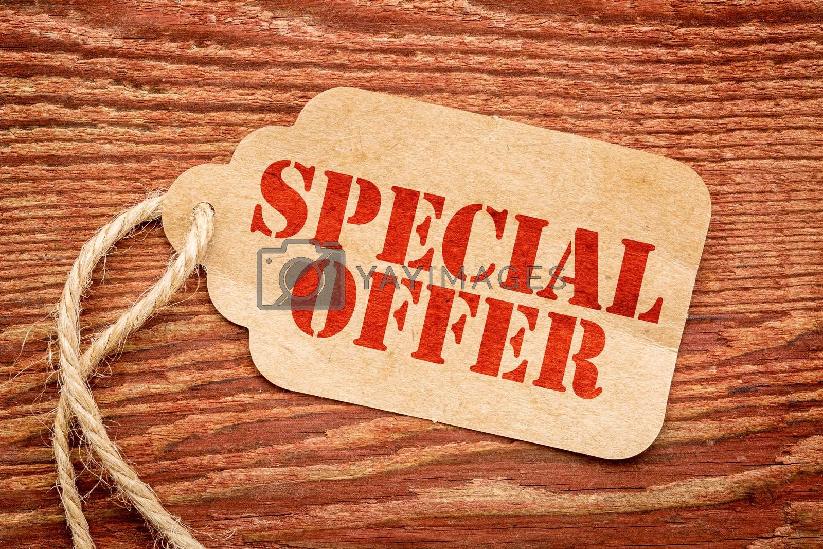 special offer sign a paper price tag against rustic red painted barn wood