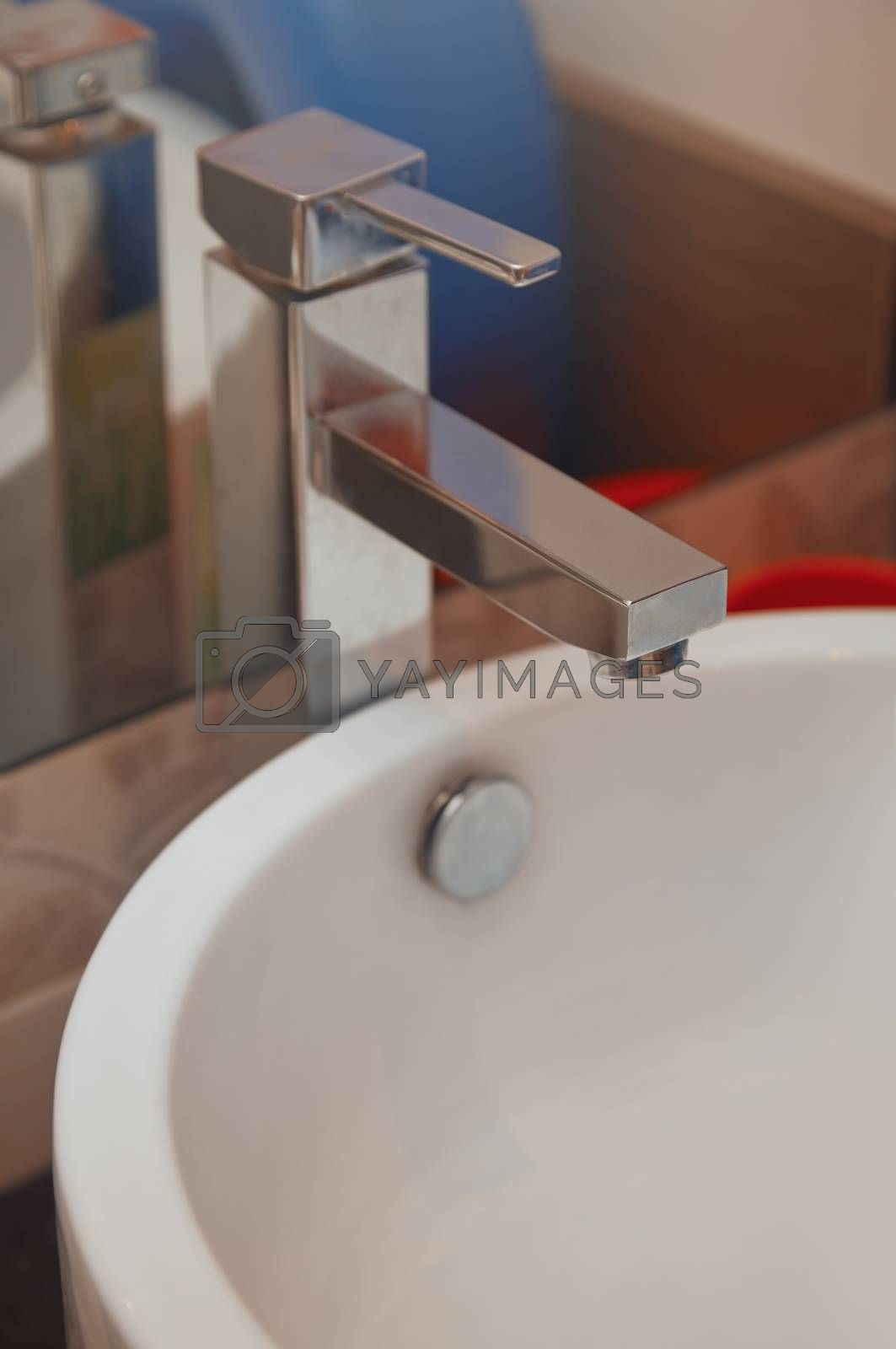 Sink and water tap. Horizontal close-up photo