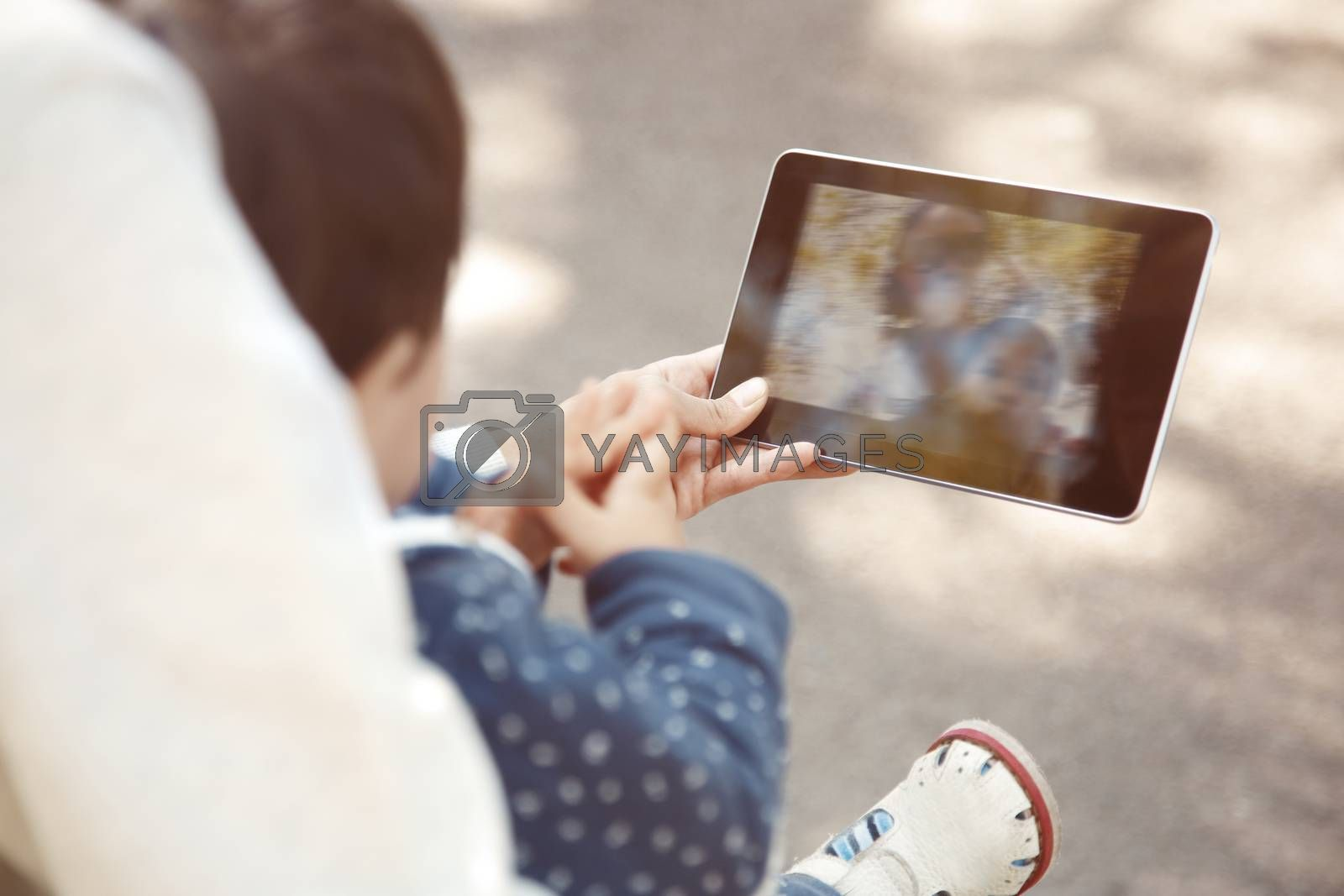 Mother and child making self-photo by digital tablet