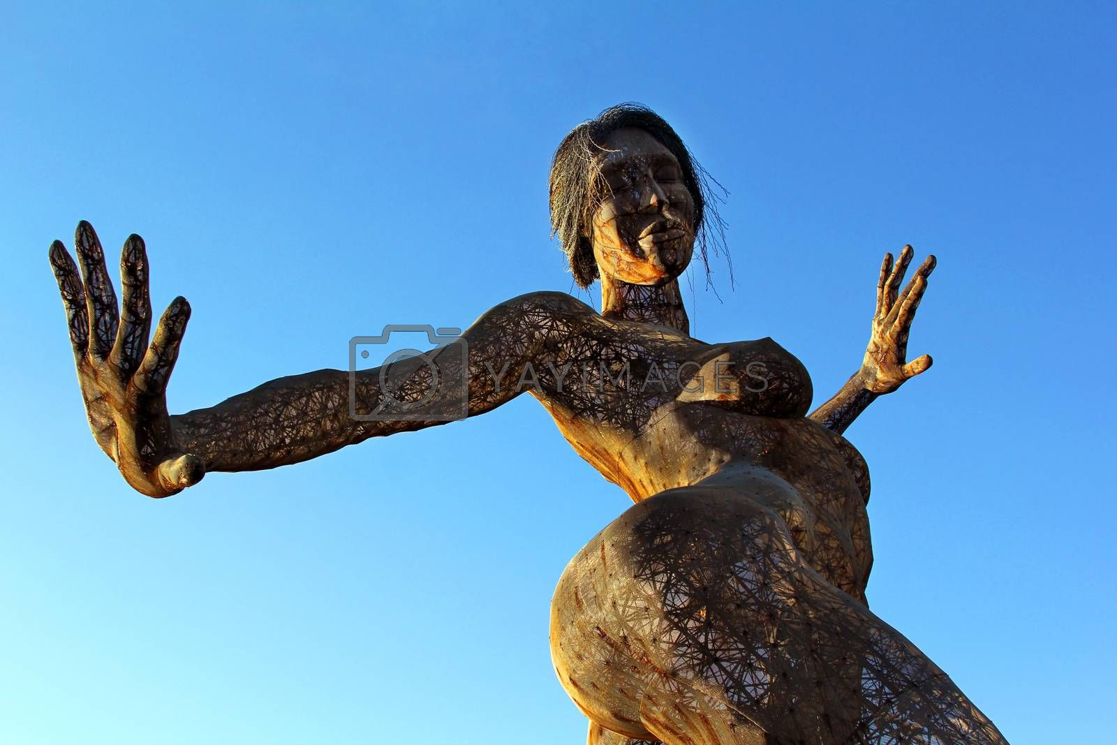 San Francisco, CA, USA - October 24, 2012: 40-foot mesh sculpture of a woman called Bliss Dance by artist Marco Cochrane on Treasure Island in San Francisco