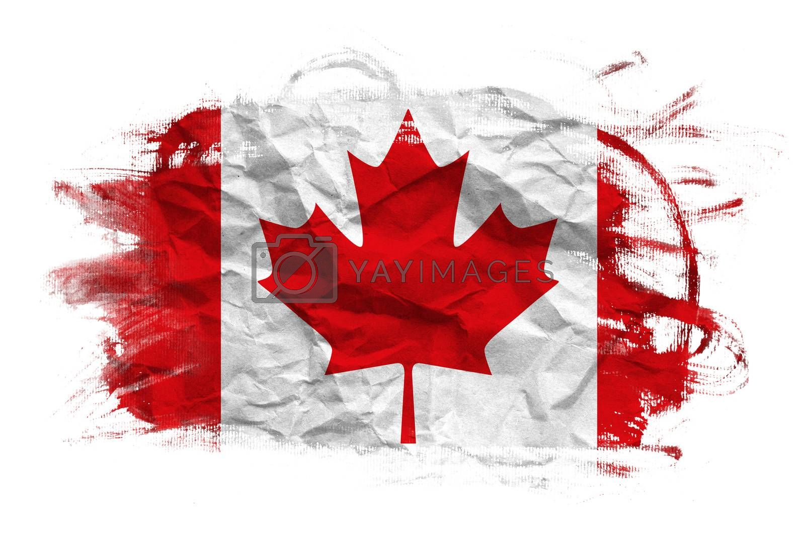 Canada flag on crumpled paper texture. Old recycled paper background.