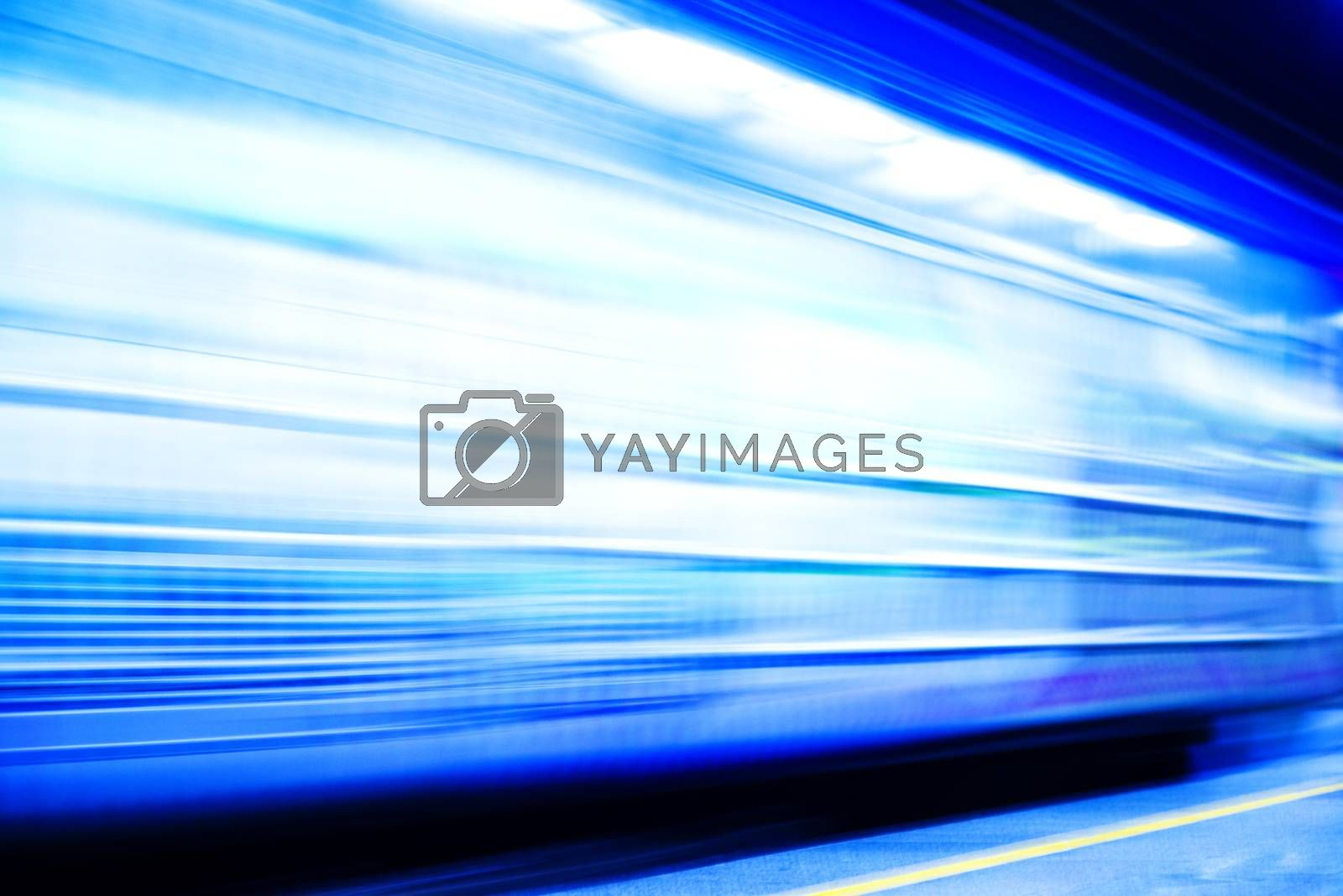 Subway train in the station. High speed train with motion blur.