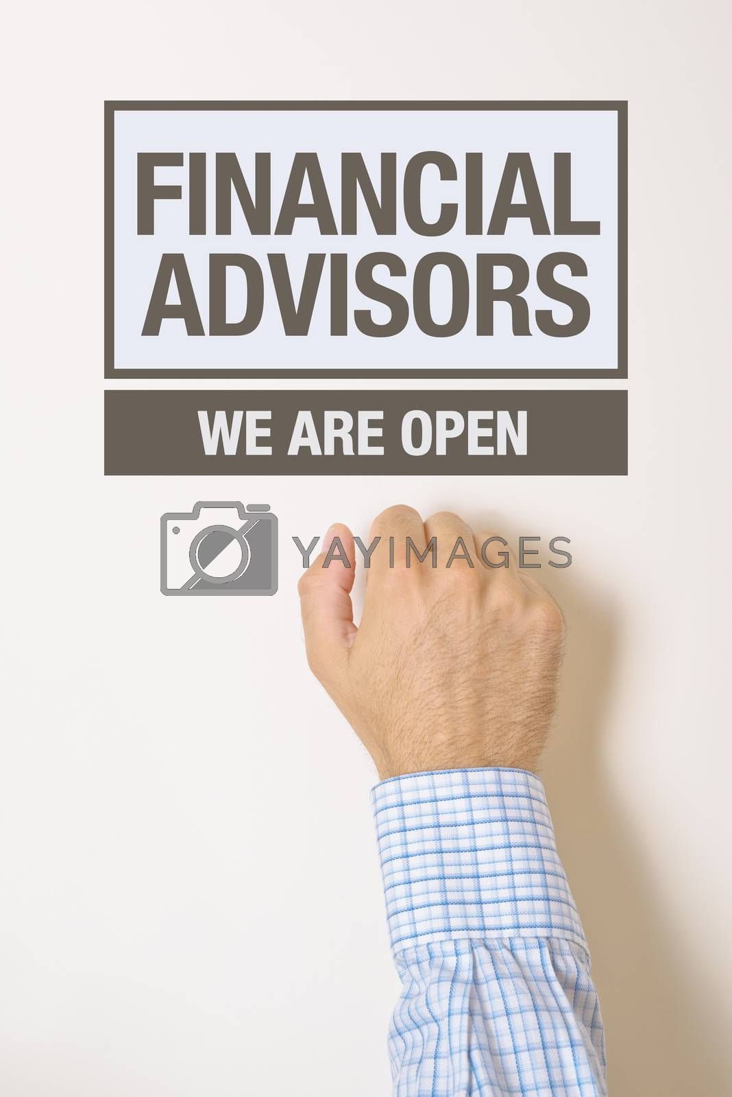 Royalty free image of Businessman knocking on Financial Advisors office door by stevanovicigor
