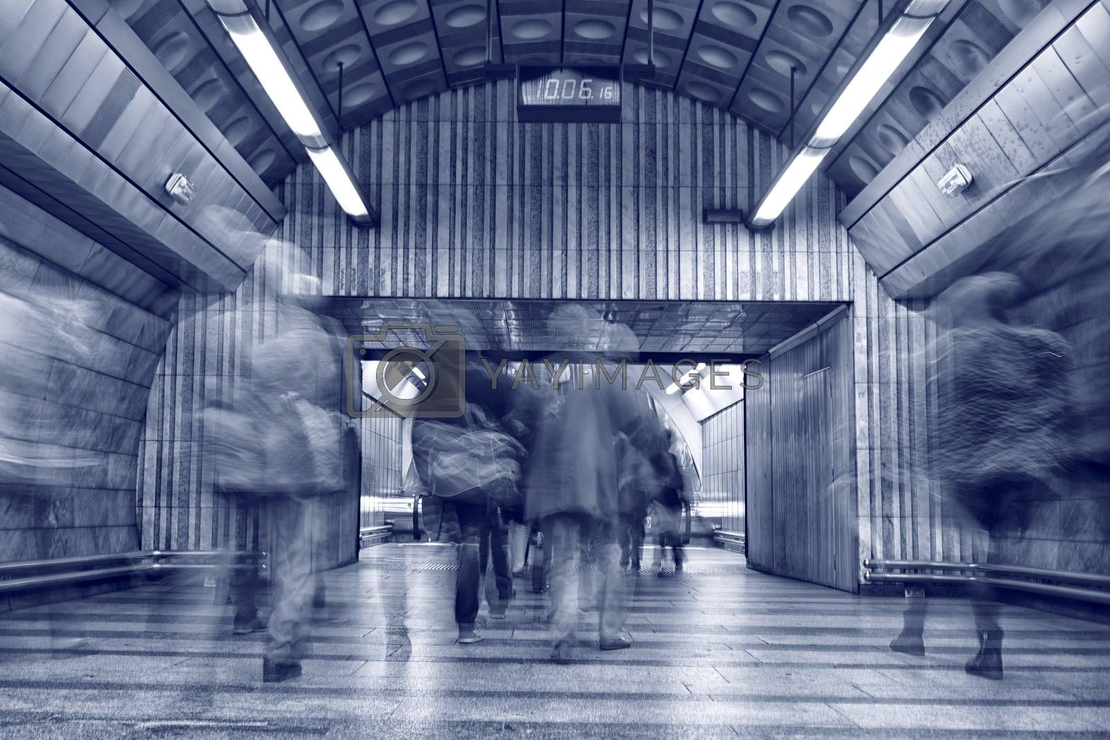fast moving people at subway train station, long exposure image