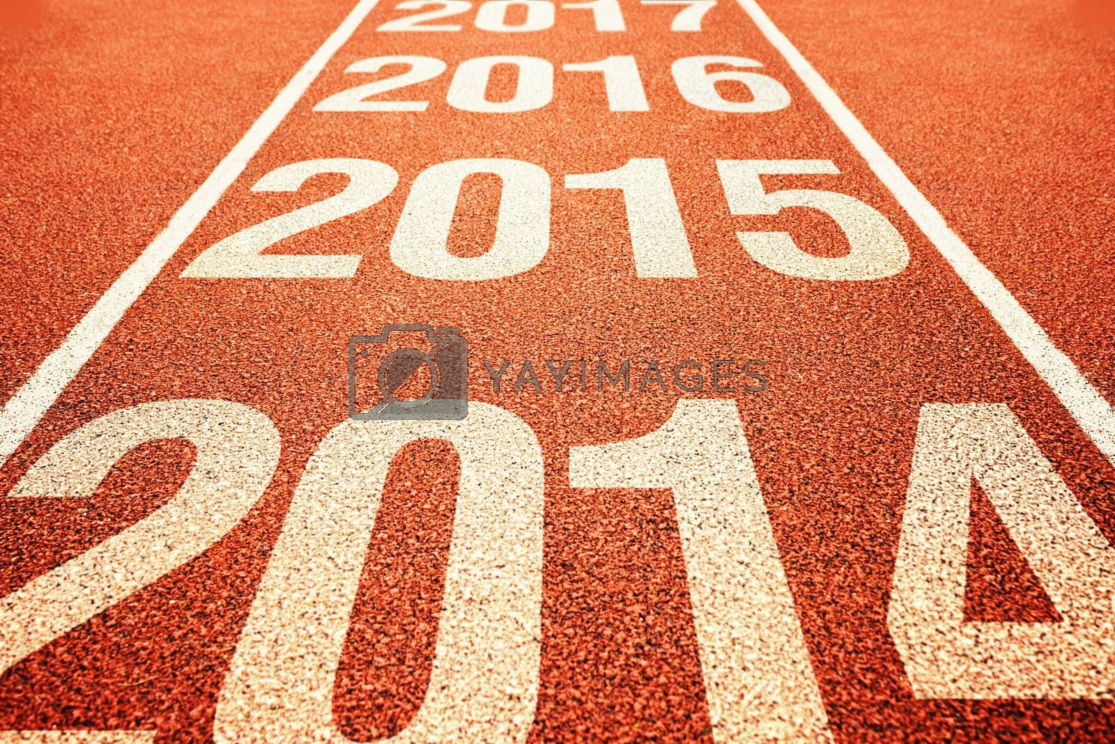 Number 2015 on athletics all weather running track withe preceeding and following years. Happy new 2015 year. Running fast towards New Year.