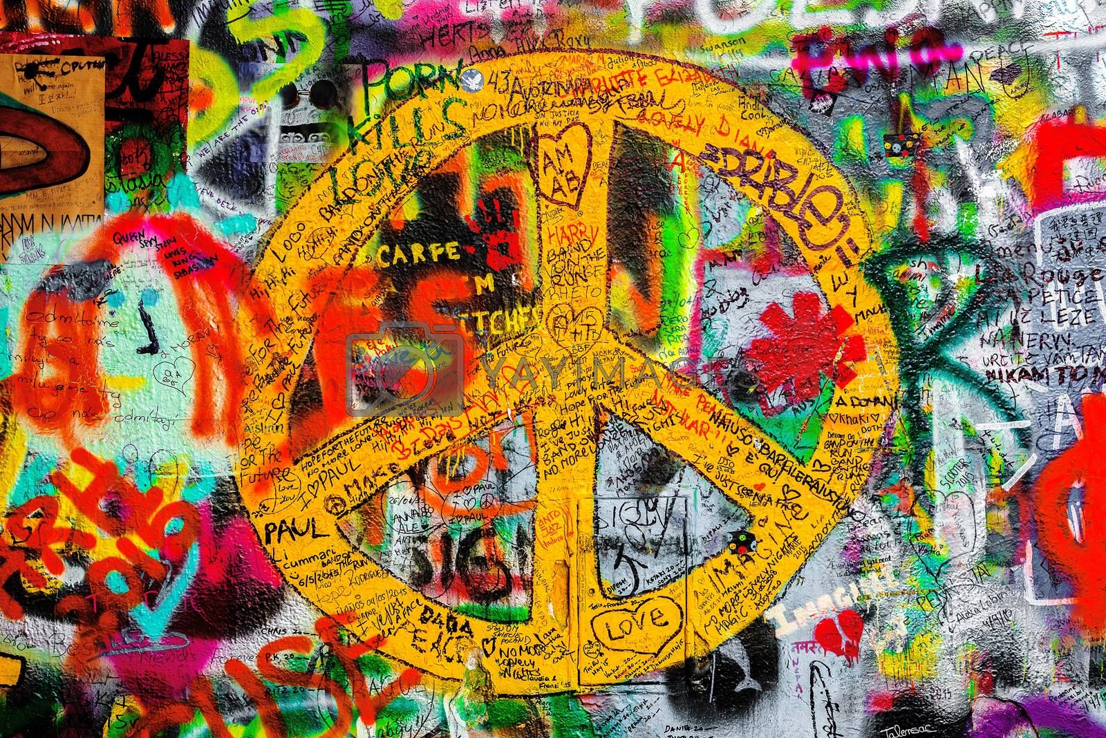 PRAGUE, CZECH REPUBLIC - MAY 21, 2015: Peace Sign on Famous John Lennon Wall on Kampa Island in Prague filled with Beatles inspired graffiti and lyrics since the 1980s.
