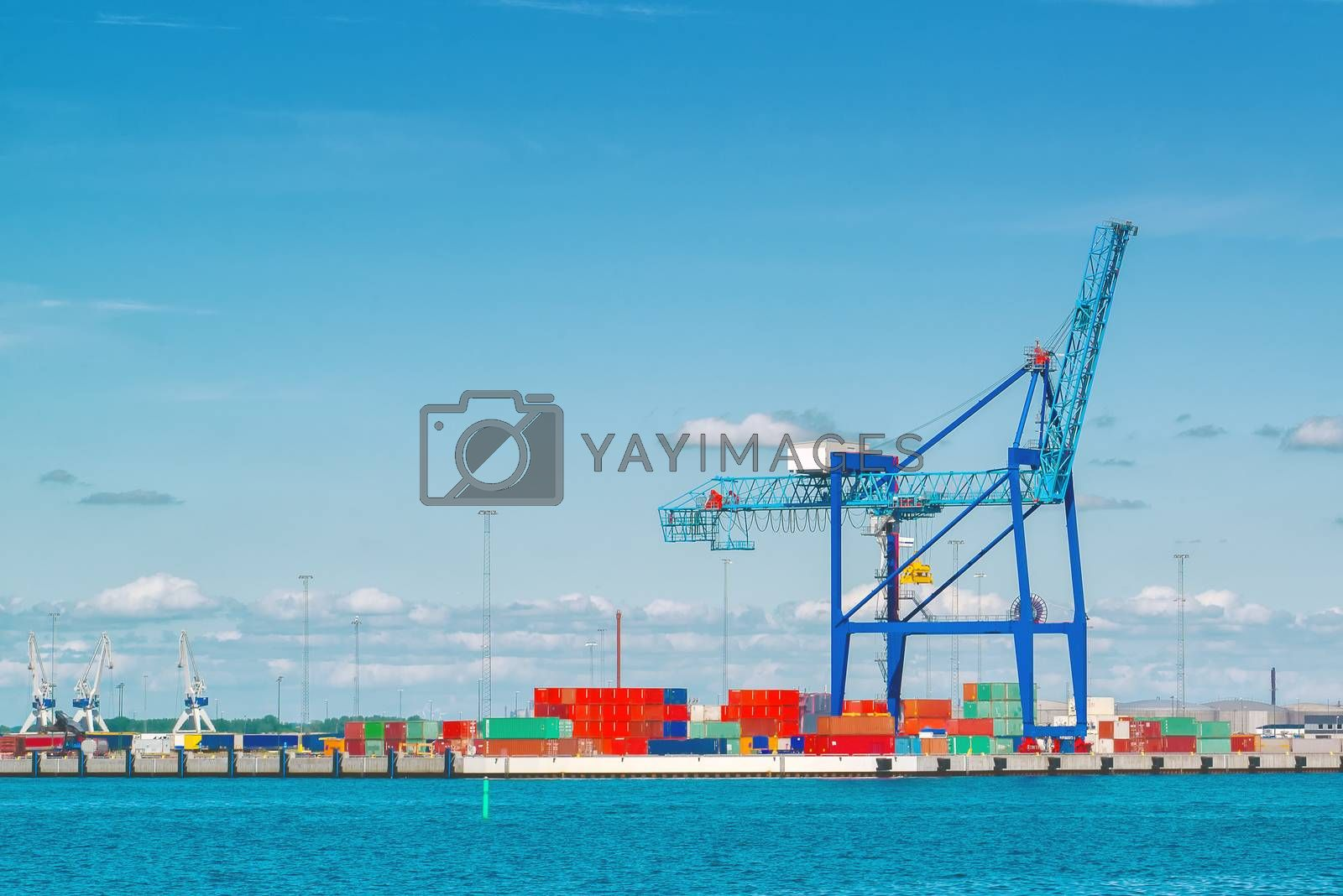 Industrial Sea Port with Loading Crane and Colorful Cargo Containers on Bright Sunny Day