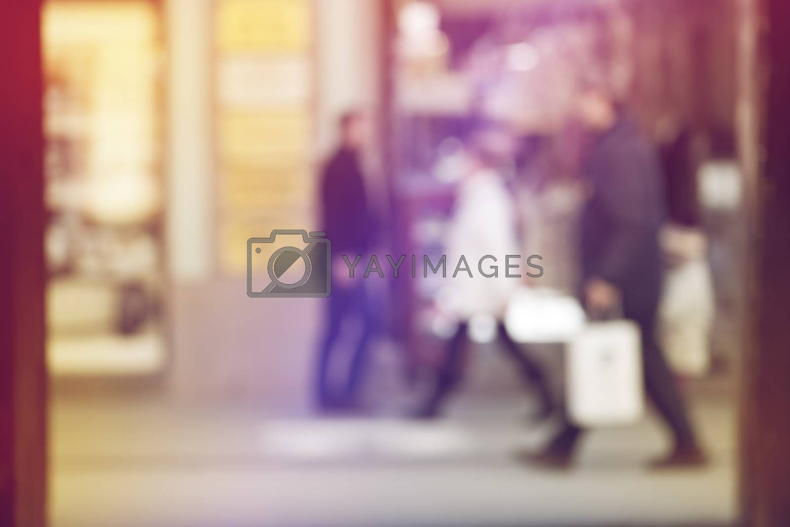 Crowd of People Walking On the Street in Bokeh, unrecognizable group of men and women as blur urban background
