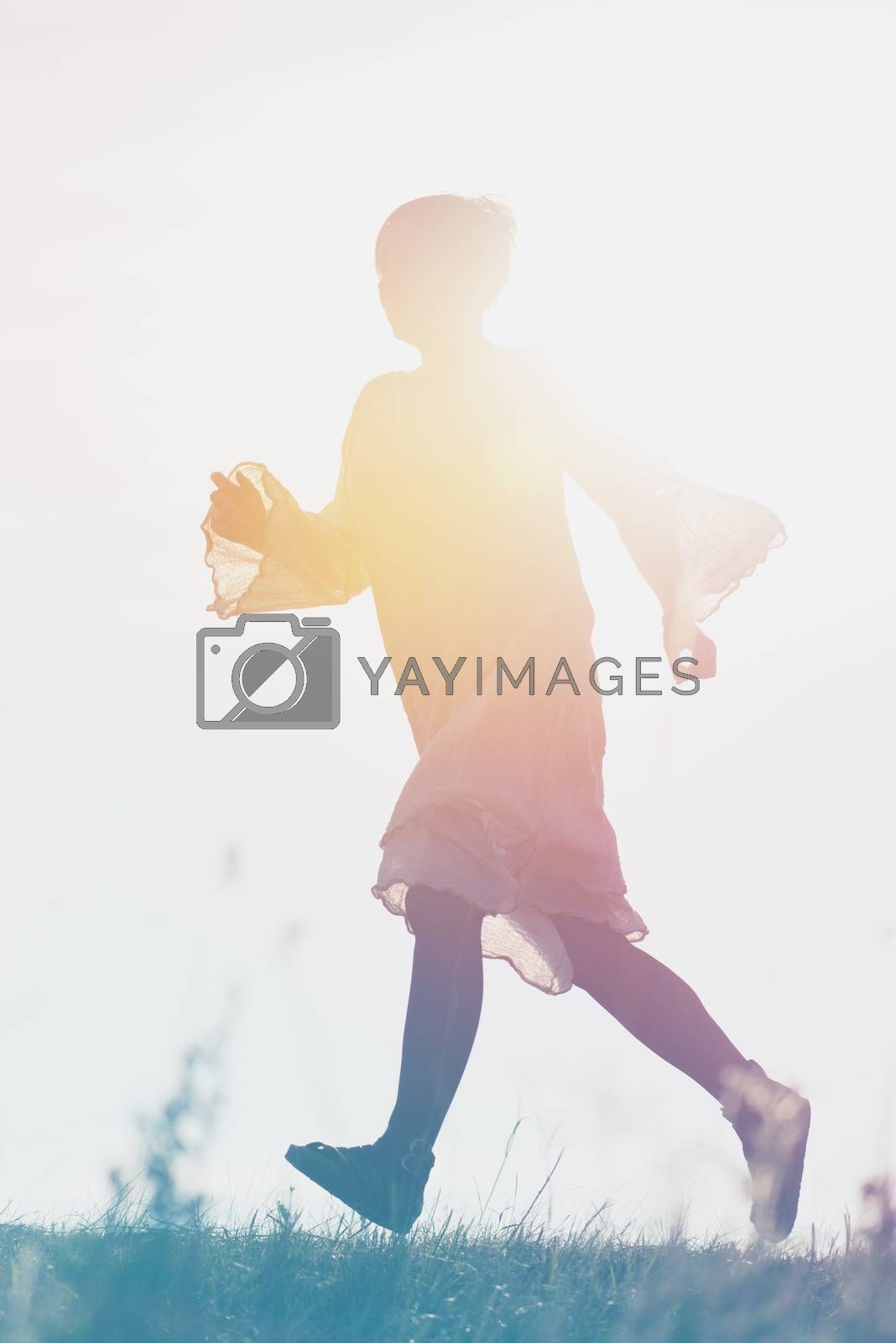 Woman Running to Freedom Through Countryside Field, Back Lit Silhouette of Female Person, Double Exposure, Vintage Retro Tone Effect.