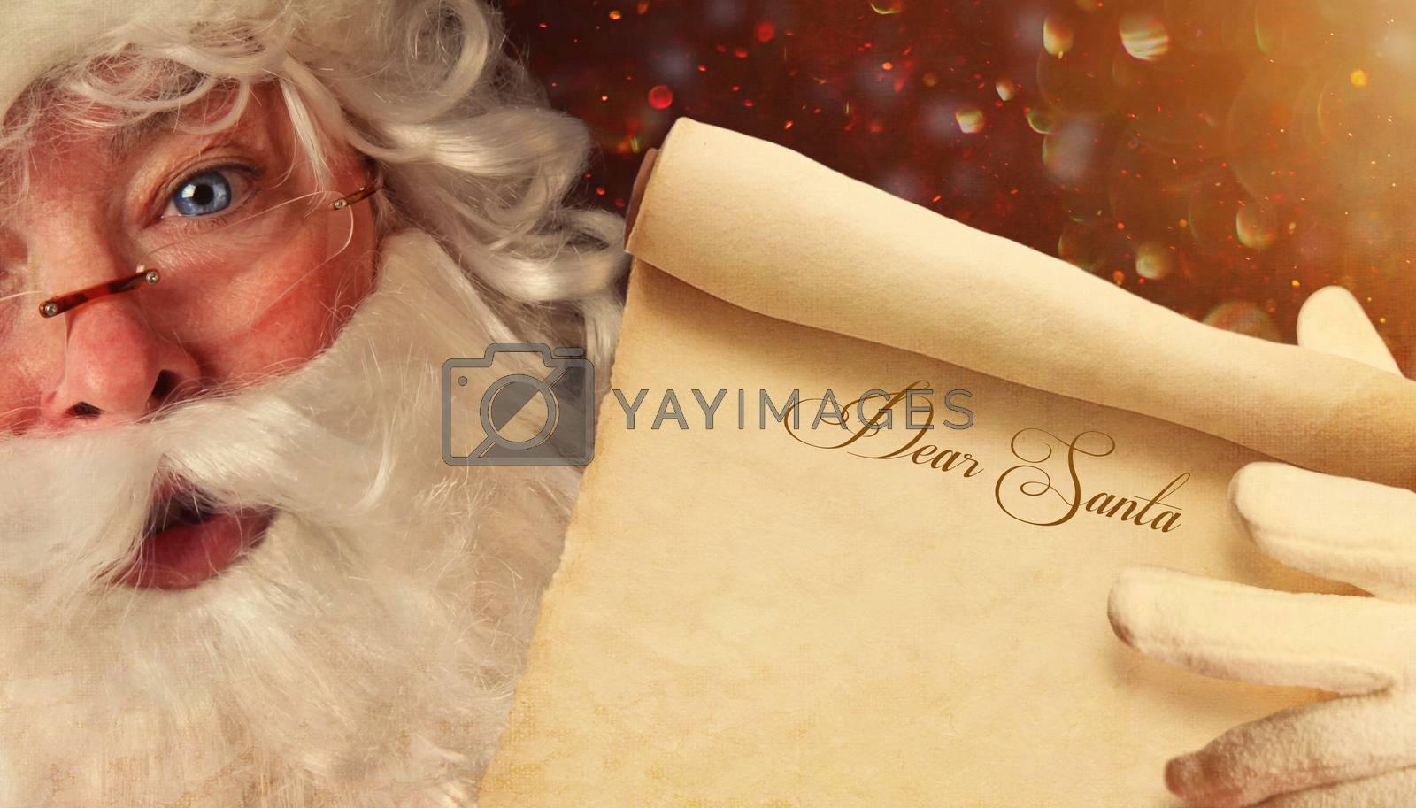 Closeup of Santa Claus holding a Dear Santa scroll