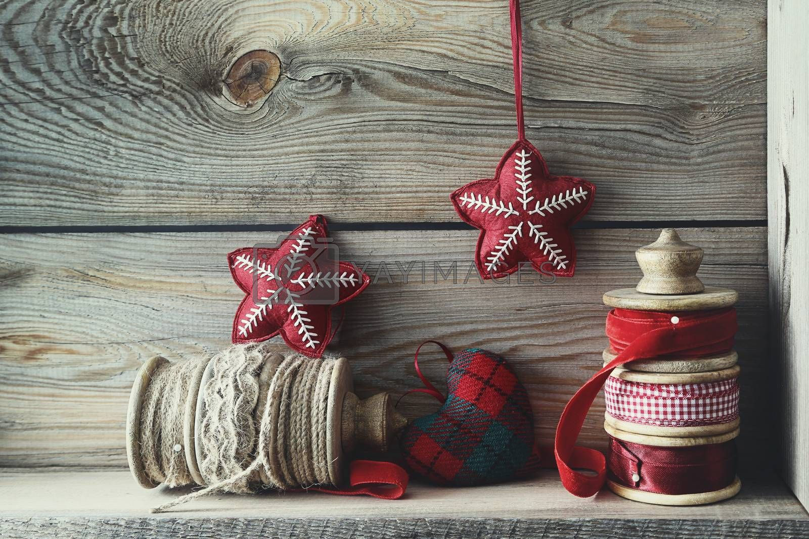 Ribbons and holiday ornaments on wood shelf