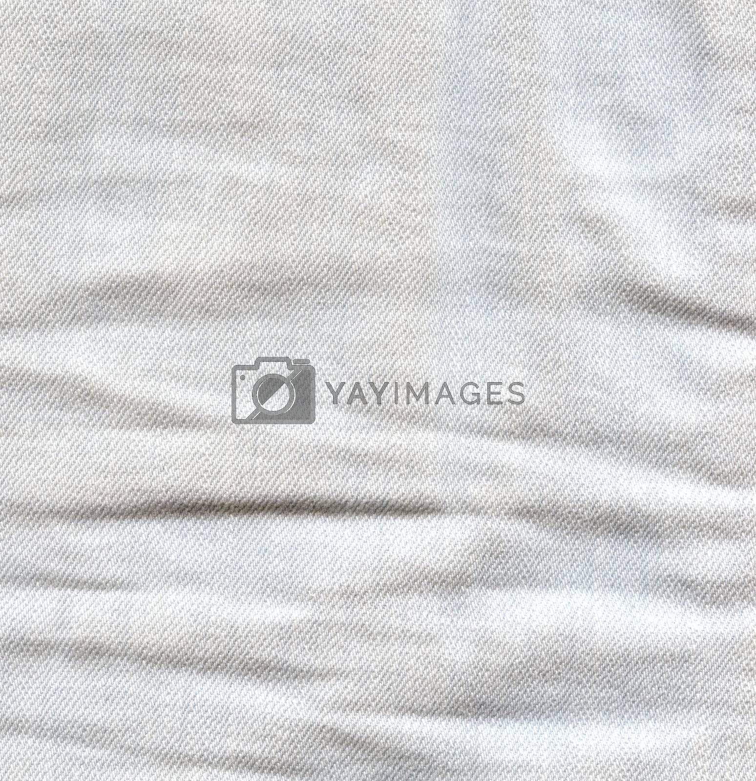 Light crumpled jeans background. Creased denim surface. White gray color canvas texture