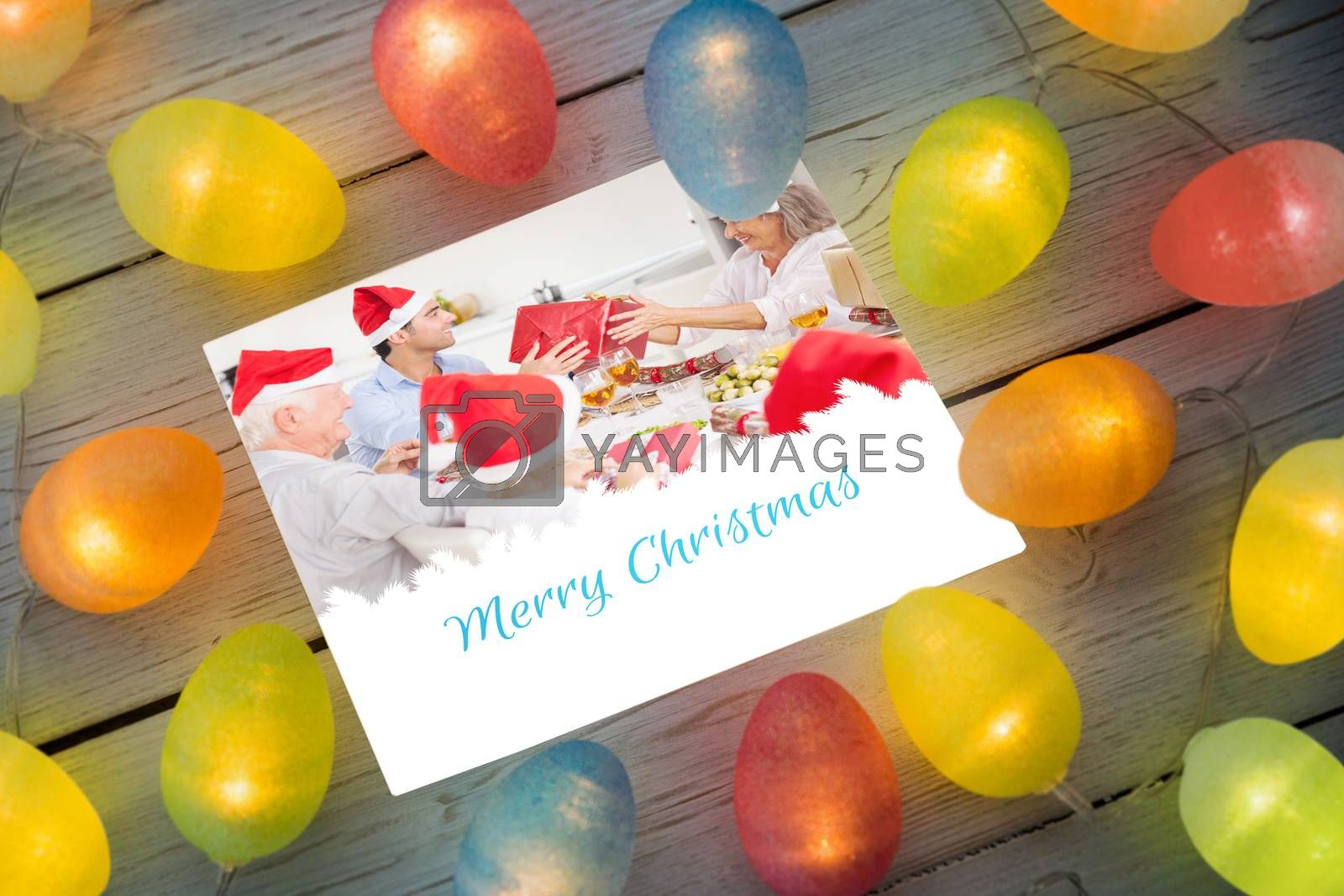 Christmas lights on table against a happy family christmas card