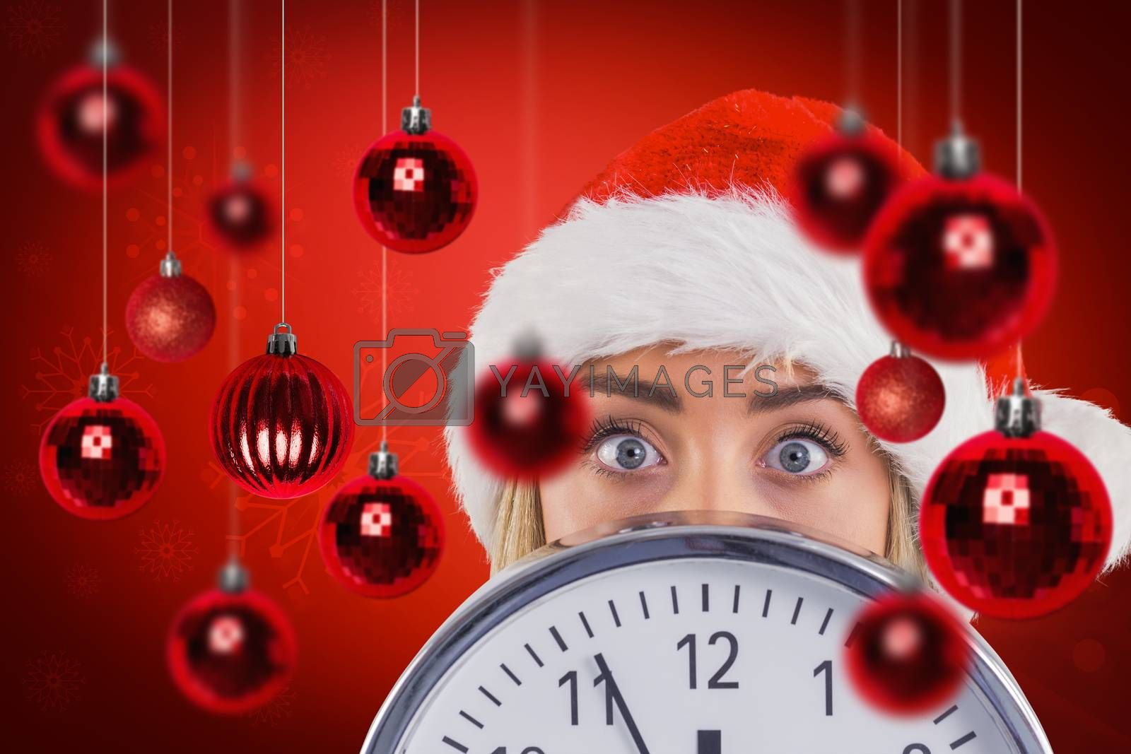 Composite image of festive blonde showing a clock by Wavebreakmedia