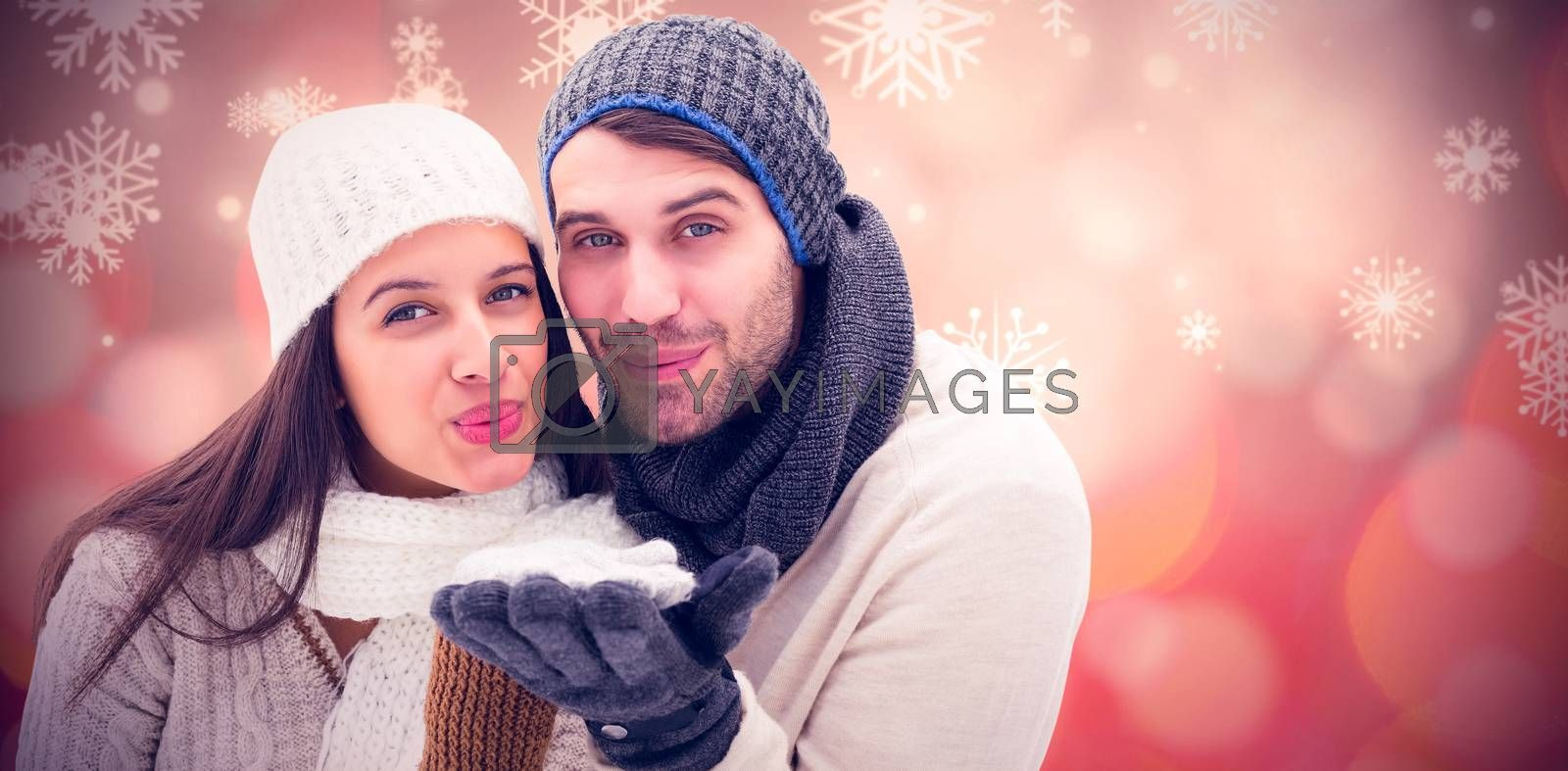 Young winter couple against glowing christmas background