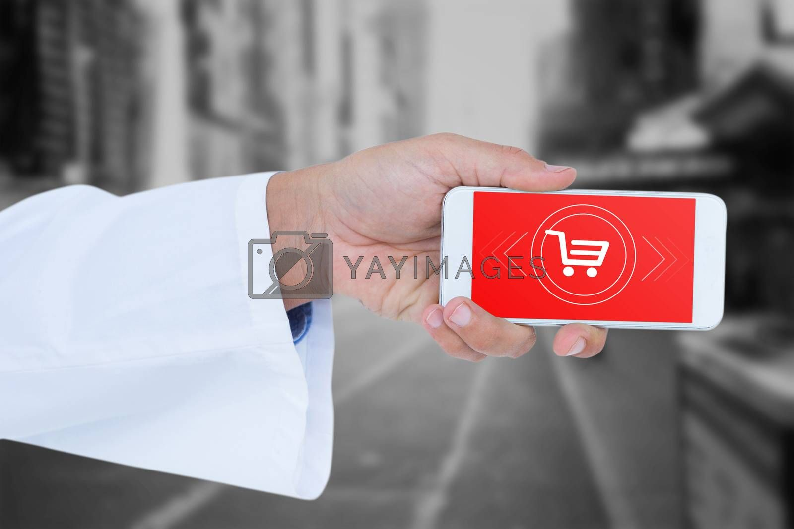 Male doctor holding smart phone with blank screen against blurry new york street