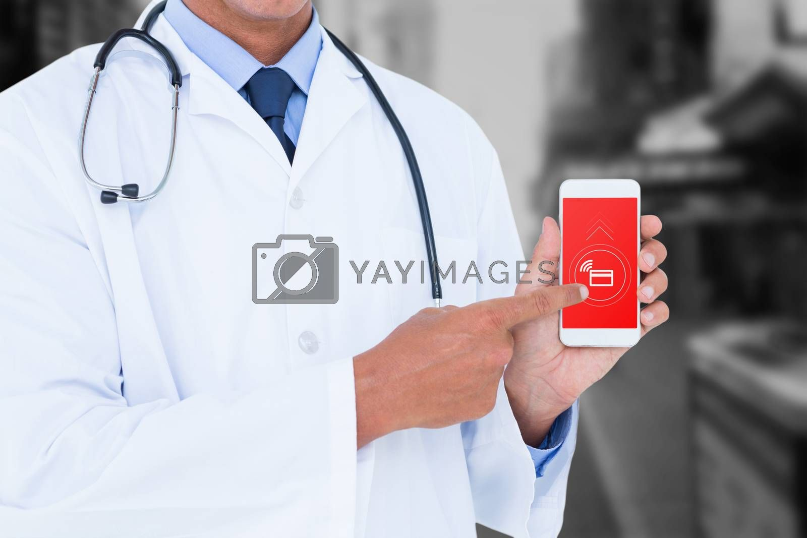 Midsection of male doctor pointing on mobile phone against blurry new york street