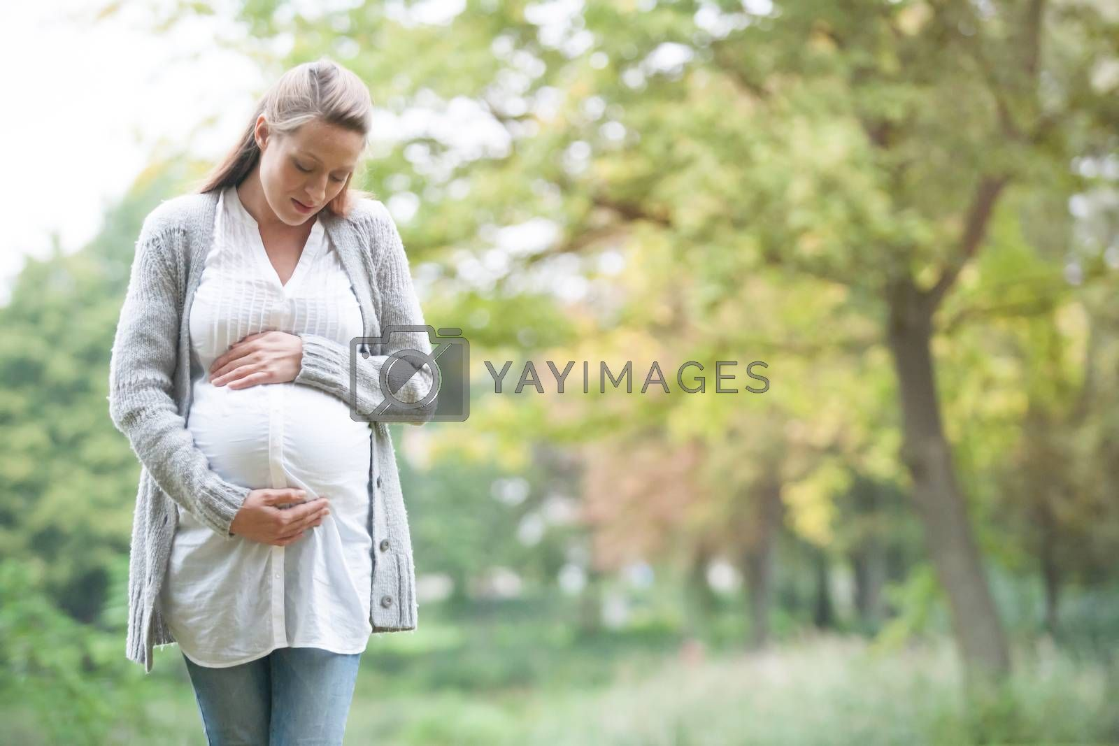 Young new mother is having fun outside