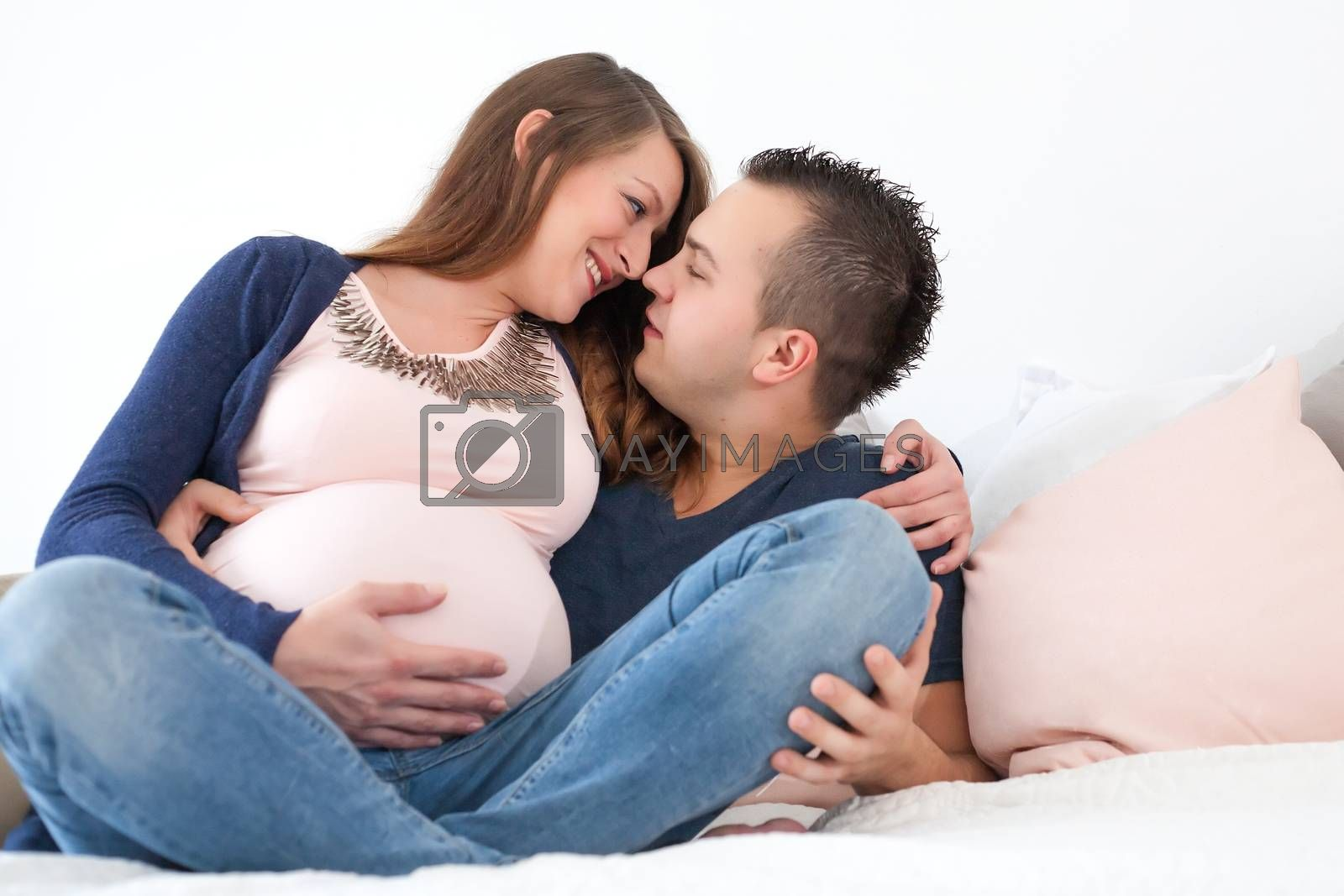 Young pregnant couple is waiting for their little girl