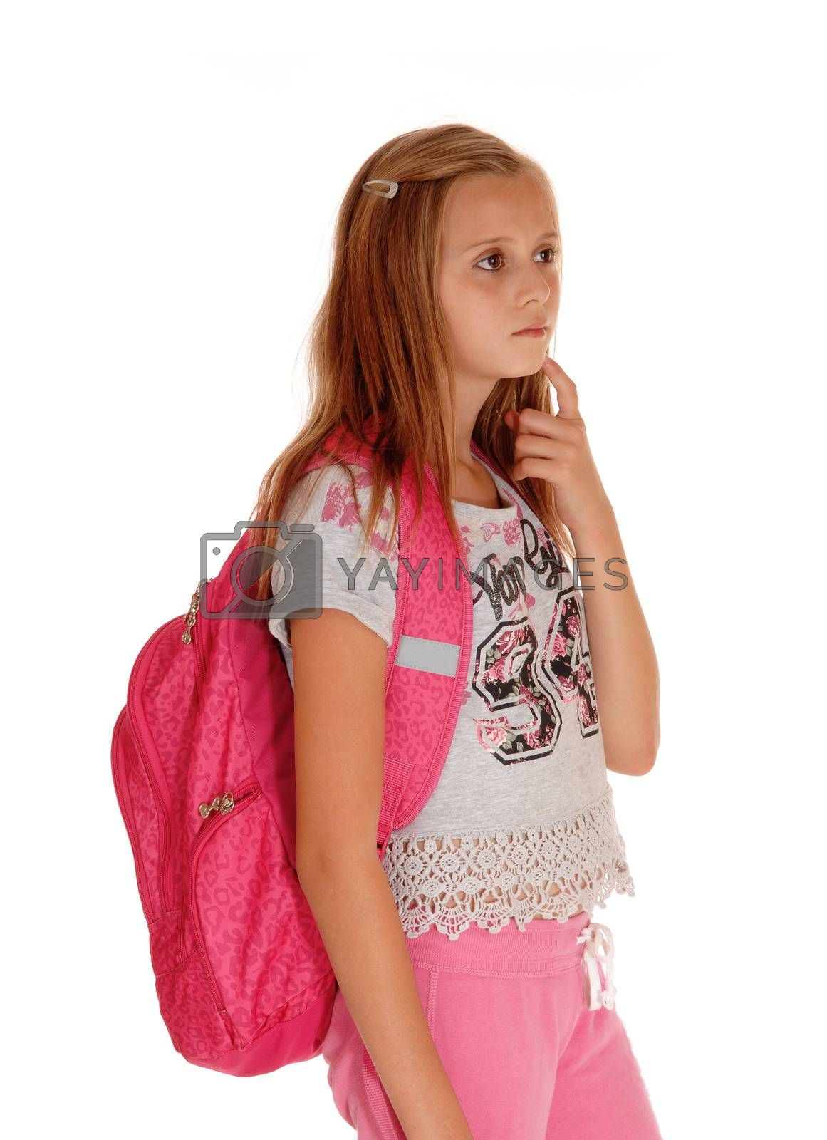 A blond pretty girl standing with her pink backpack for school, looking up and thinking, isolated for white background.