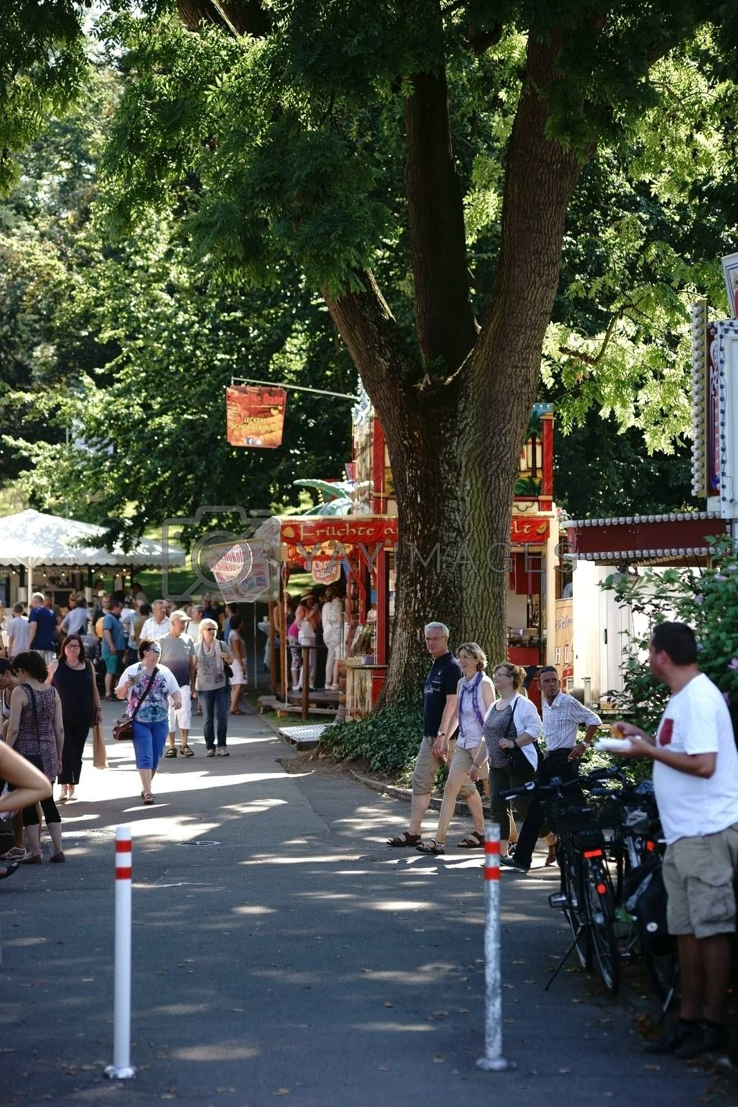 Mainz, Germany - August 29, 2015: Wine lovers and Art lovers visited the artists' market on the Mainz Wine Market in the city park and rose garden on August 29, 2015 in Mainz.