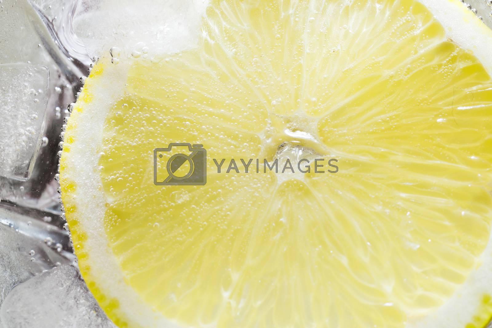 The photo depicts a lemon in bubbles