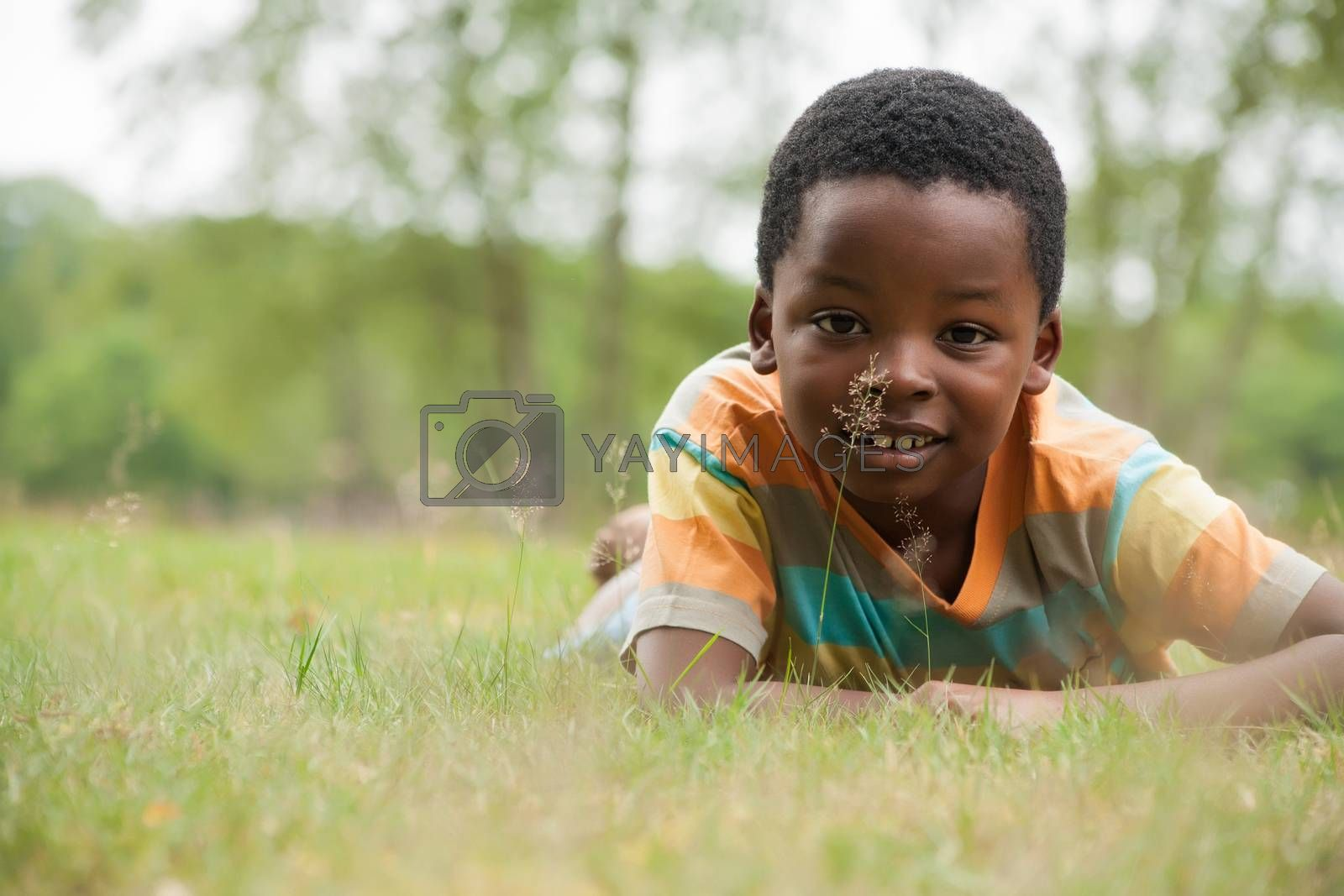 African boy in the grass by DNFStyle